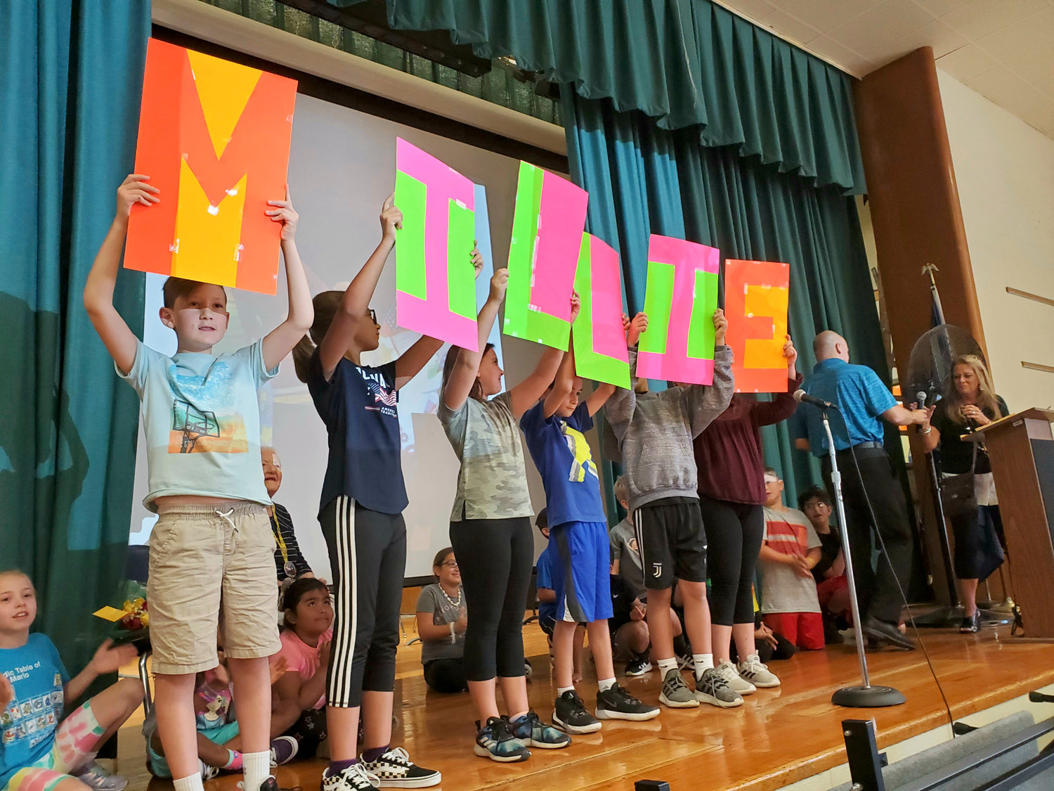 East Broadway Elementary students performed a poem based on the acronym 'MILLIE', Bowman's nickname.