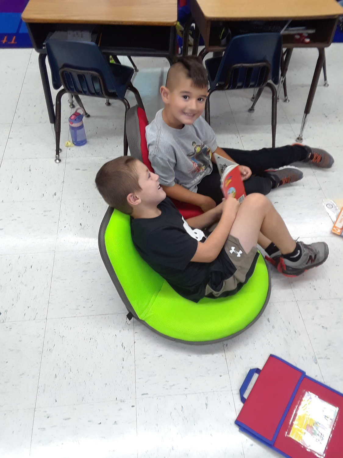 Seaford Manor students Ryan Donely, left, and Thomas Cottone took a break from reading together at Seaford Harbor School on Sept. 19.