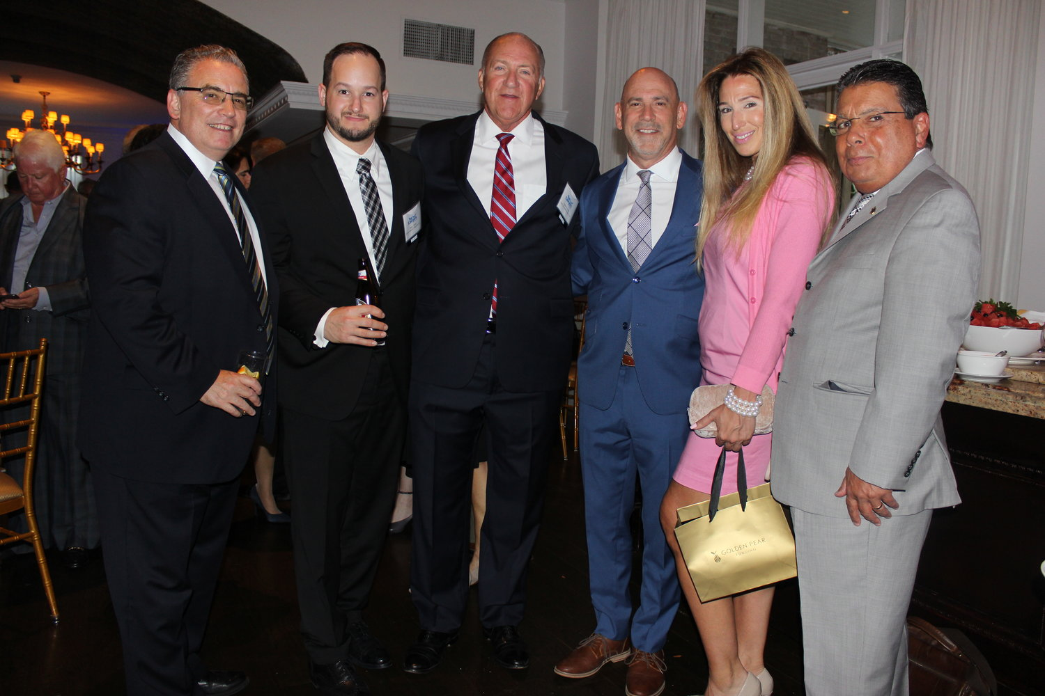 Mingling at the networking and cocktail party were, from left, Brett Harrison, Honoree Ross Kartez, Honoree Frederick Johs, Honoree Jeffrey Kimmel, Connie Henriquez and Frank Torres.