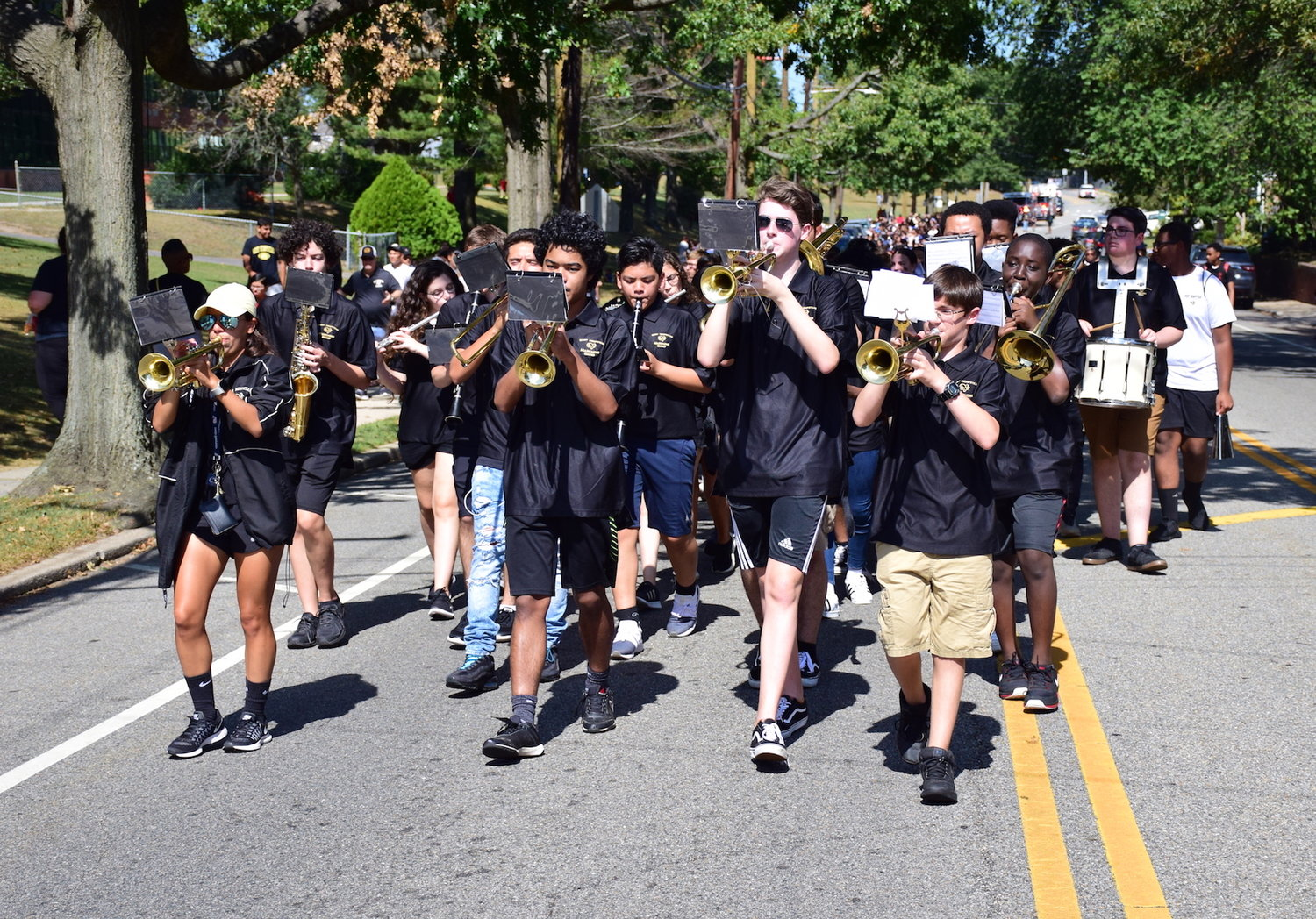 The high school marching band paraded down Nassau Boulevard.