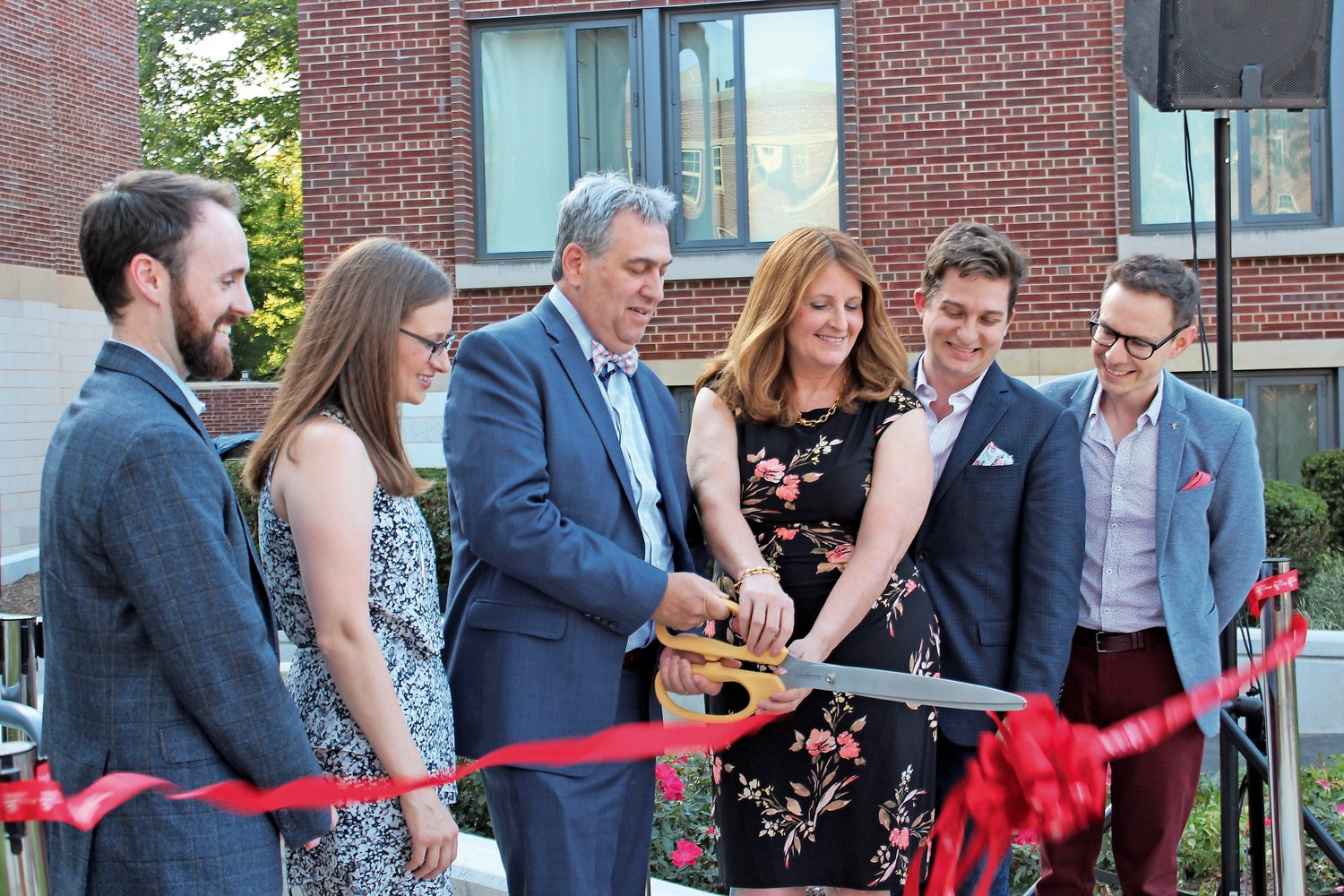 Drew and Karen Bogner, center, cut the ribbon to Bogner Hall with, from left, son-in-law Tom Kelly, daughter Lindsay Kelly, son Ryan Bogner and his husband, Alek Hoyos.