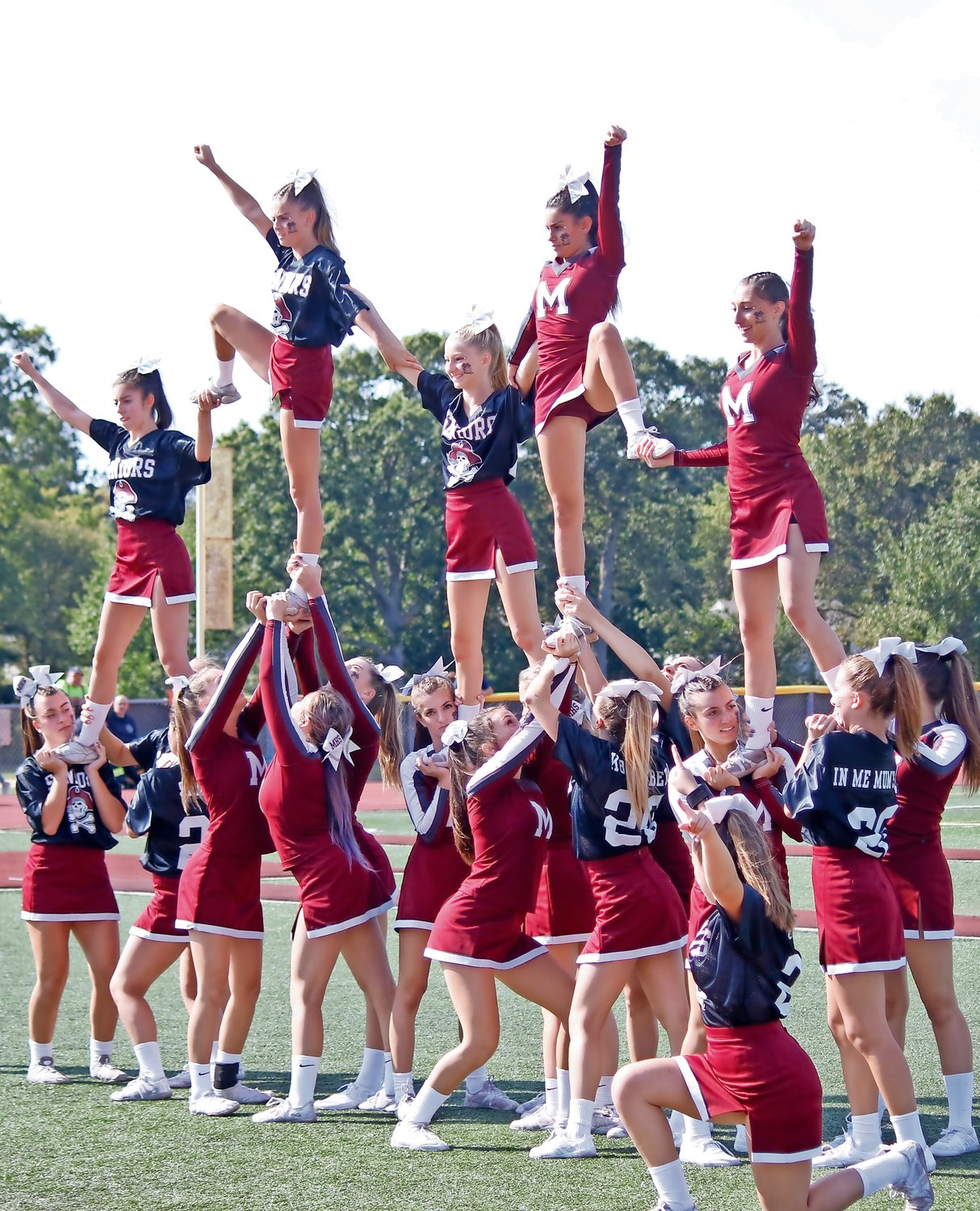 The Mepham cheer team warmed up for their halftime performance.