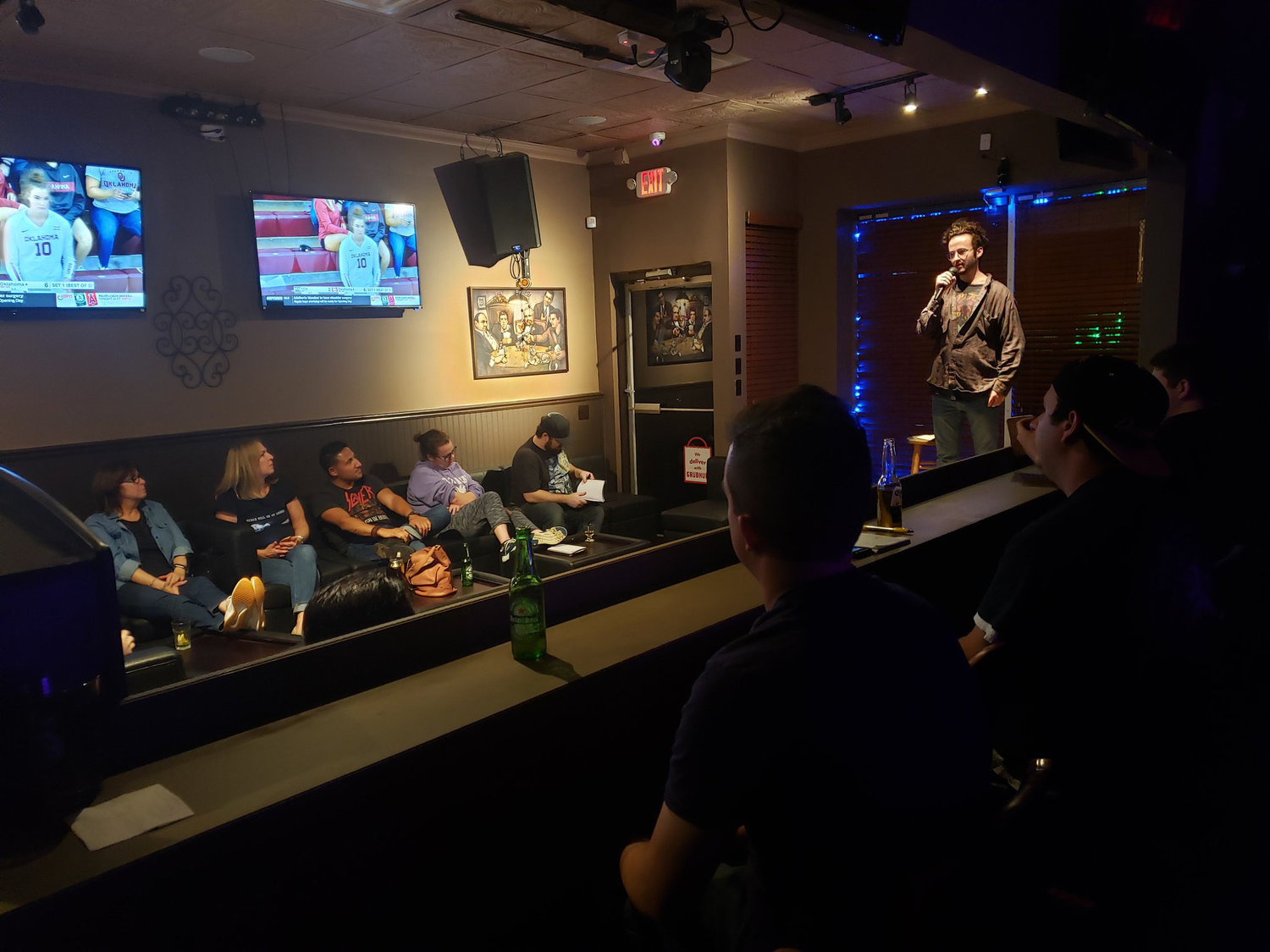 Open mic regulars listened on as Abe Hannigan worked through his seven-minute set at the Vintage Bar and Lounge in Wantagh on Sept. 25.