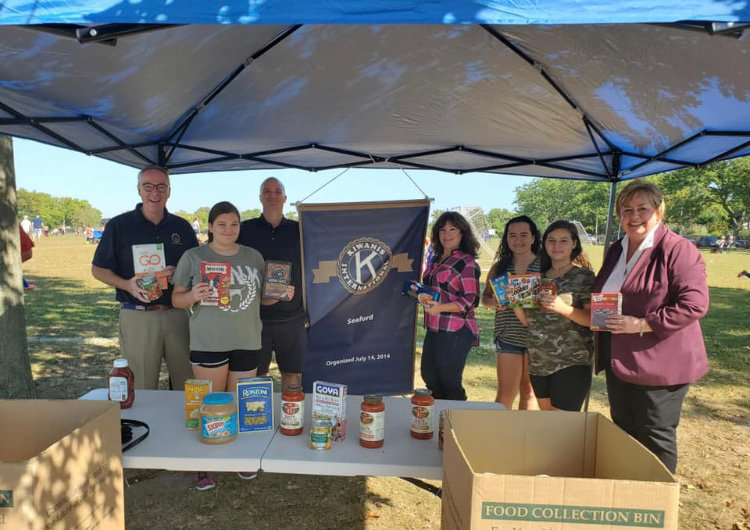 Donald X. Clavin, far left, and Kate Murray, far right, joined members of the Seaford community who donated non-perishable items at the food drive.