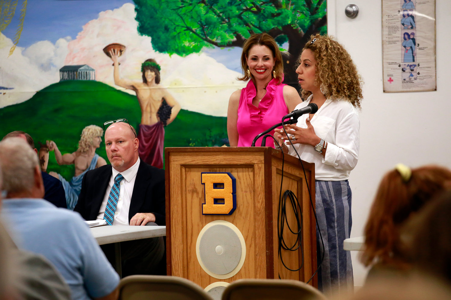 Marwa Fawaz, at lectern, a VHB Engineering senior project manager, told Baldwin residents at a meeting in July that a new zoning ordinance would address flooding concerns. With her was Erin King Sweeney, who recently resigned from the Hempstead Town Board.
