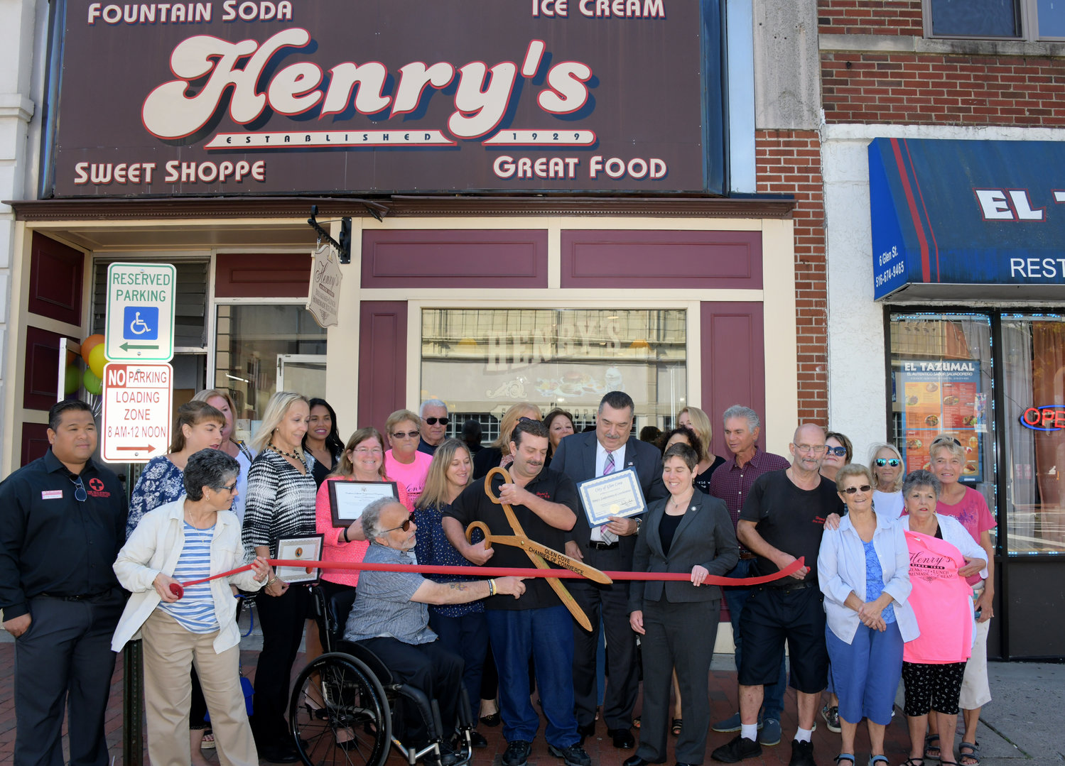 Henry's Confectionary owner Joseph Valensisi cut the ribbon to celebrate the store's 90th anniversary on Sept. 25.