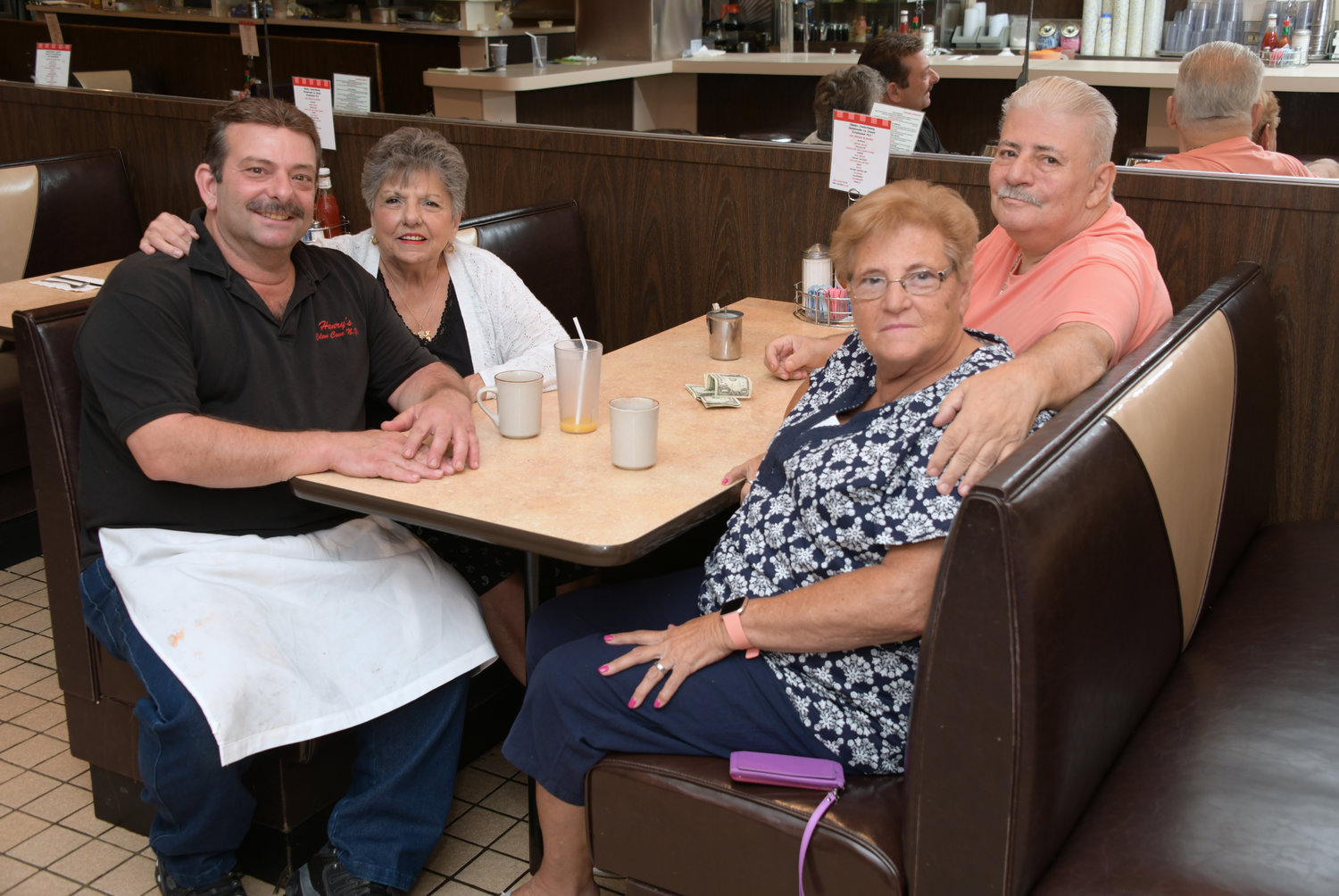 Valensisi shared coffee with customers, from left, Angie Basile and Patricia and Al Errico.