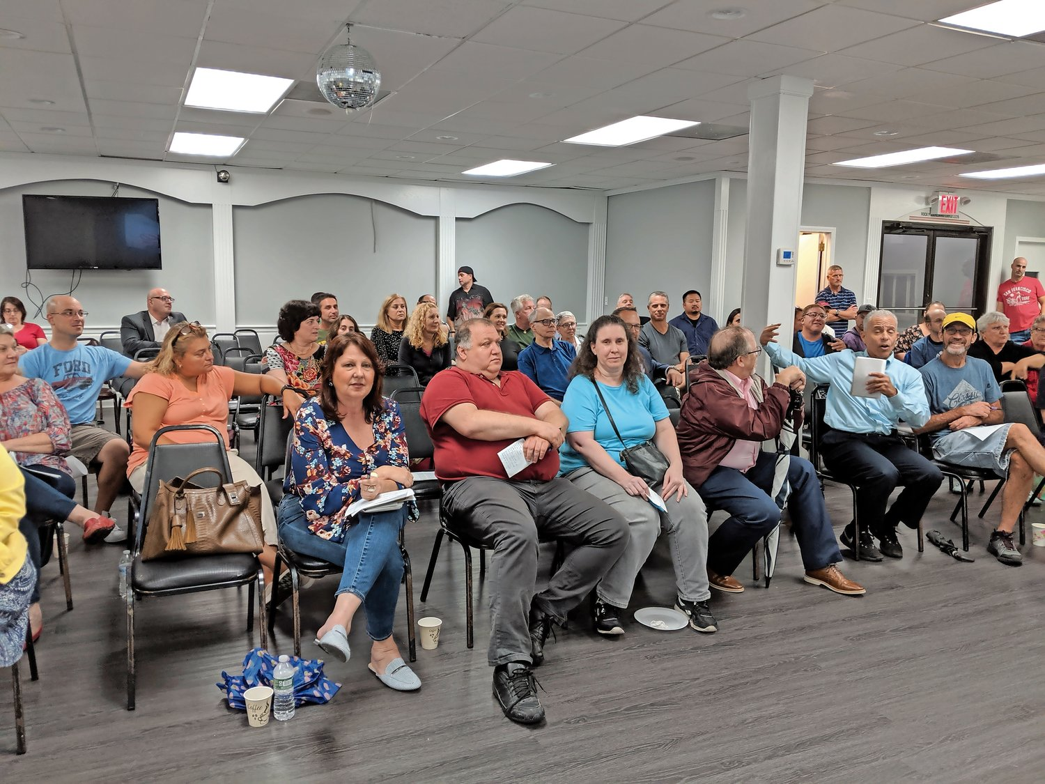 Residents gathered on Oct. 1 to discuss their opposition to a proposed development on the Oceanside Jewish Center property on Brower Avenue.