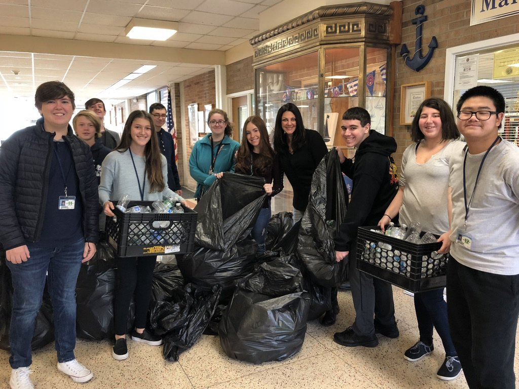 Members of C.A.R.E. collected plastic bottles every Friday during the 2018-19 school year. By exchanging them for cash, they bought a water filling station for the high school hallway.