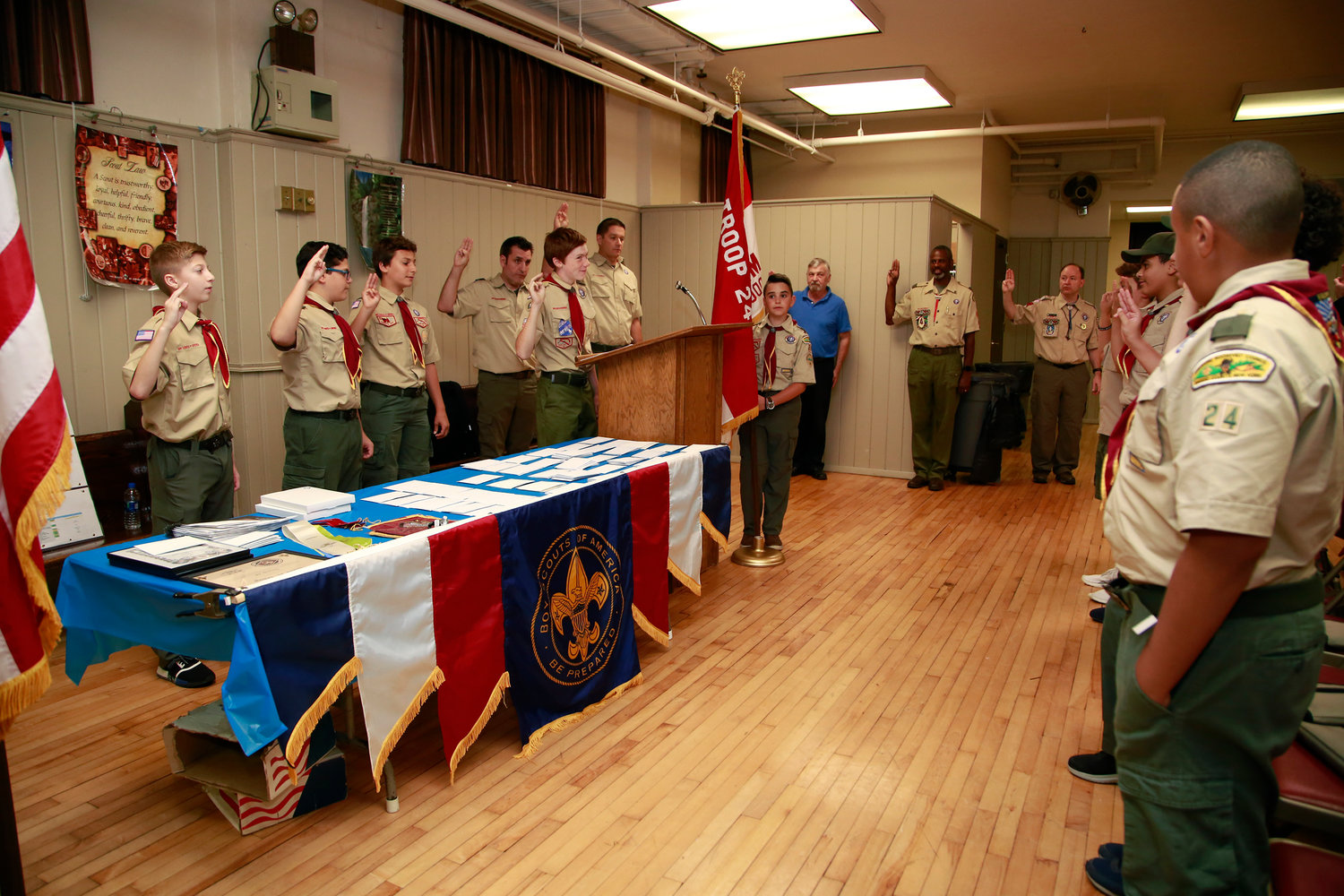 Boy Scout Troop 24 Patrol Leader A.J. Wladyka, at lectern, led the troop's Scout Oath during its Court of Honor ceremony at Our Lady of Lourdes Church on Oct. 2.