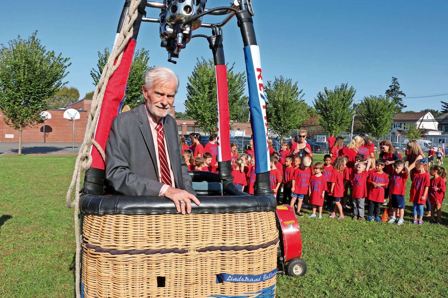 Johnson hopped into a hot-air balloon at an event at Watson School in September to promote its theme for this year, Soaring to New Heights.