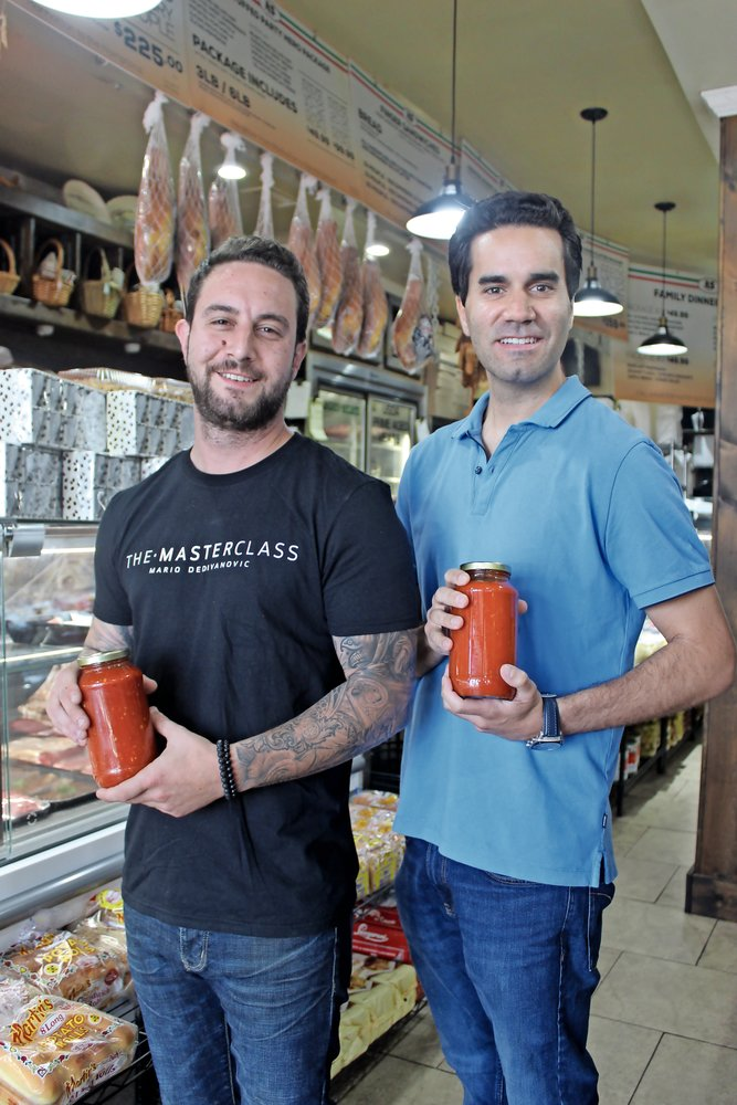 Business partners Anthony Giordano and Andrew Jedlicka displayed label-less bottles of Vinny Pastore's Italian Sauce. The design will include Pastore's signature.