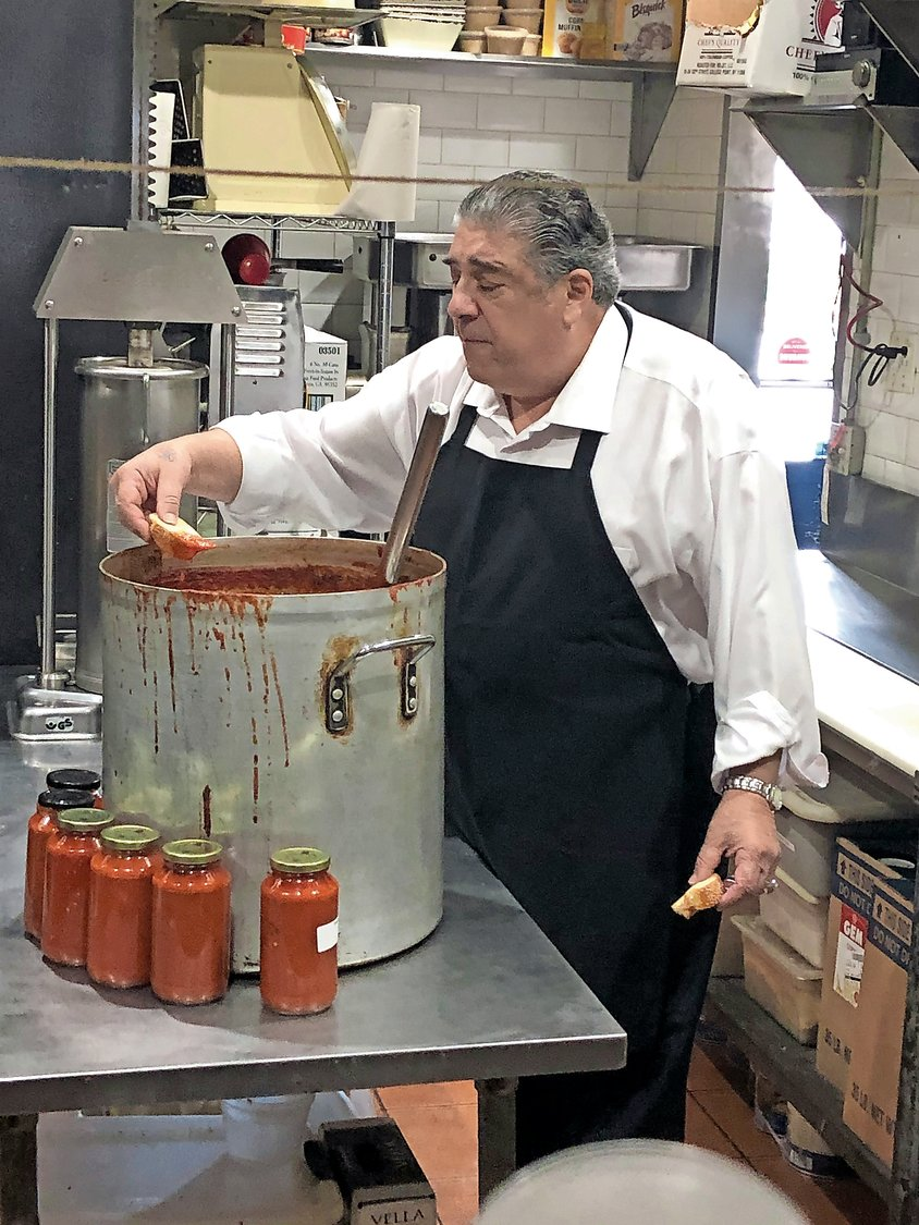 Pastore cooked up a sampling of his tomato sauce in the kitchen of A&S Fine Foods in Merrick.