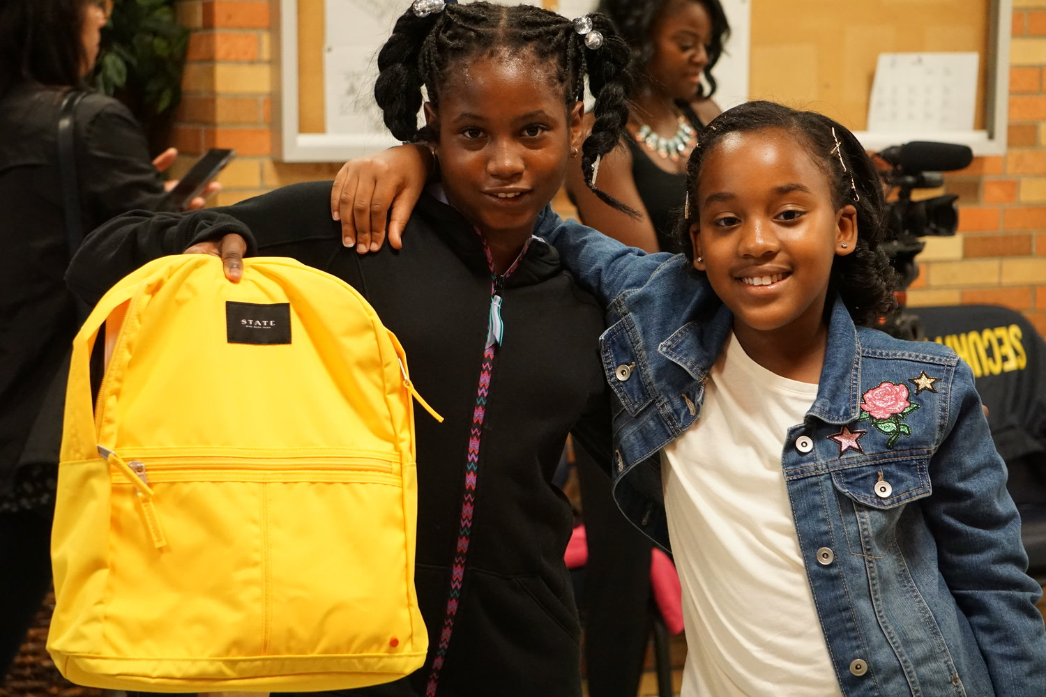 Malia Sterling, left, and Briana Cole, both 10, were two of the recipients of more than 400 backpacks donated to Shaw Avenue Elementary School on Oct. 3 by State Sen. Todd Kaminsky and STATE Bags.