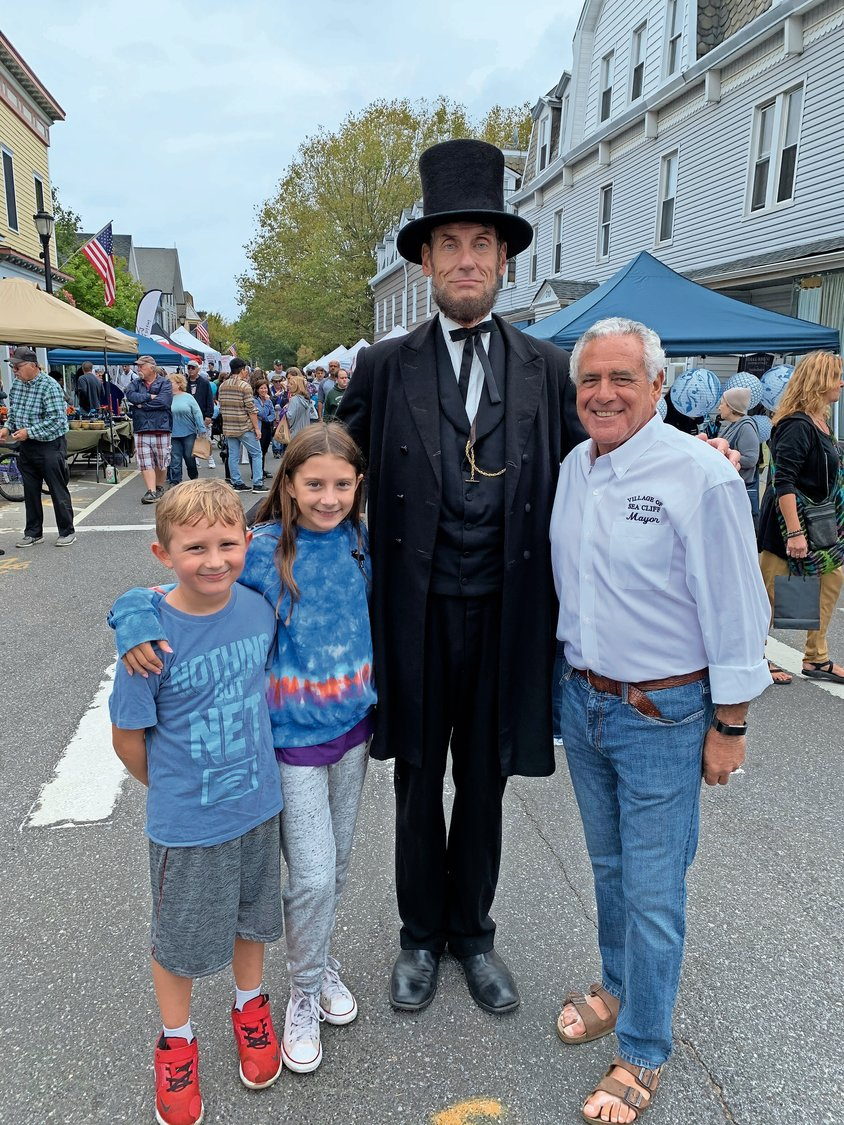 A.J. Riccardo, 8, left, and his sister, Alexa, enjoyed Don Mullen's performance as Abraham Lincoln, as did Sea Cliff Mayor Edward Lieberman.