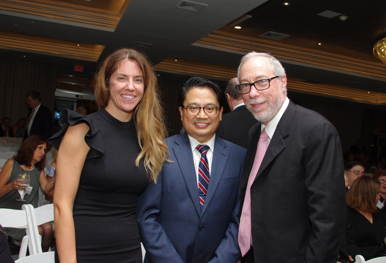 Mount Sinai South Nassau hospital hosted its annual Soiree Under the Stars gala on Sept. 28. Nurse Tracy Thorn, left, was recognized with the Cupola Award, while Dr. Ricardo Cruz, center, was honored with the Mary Pearson Award. Above, the two recipients with Department of Medicine Chairman Dr. Aaron Glatt.