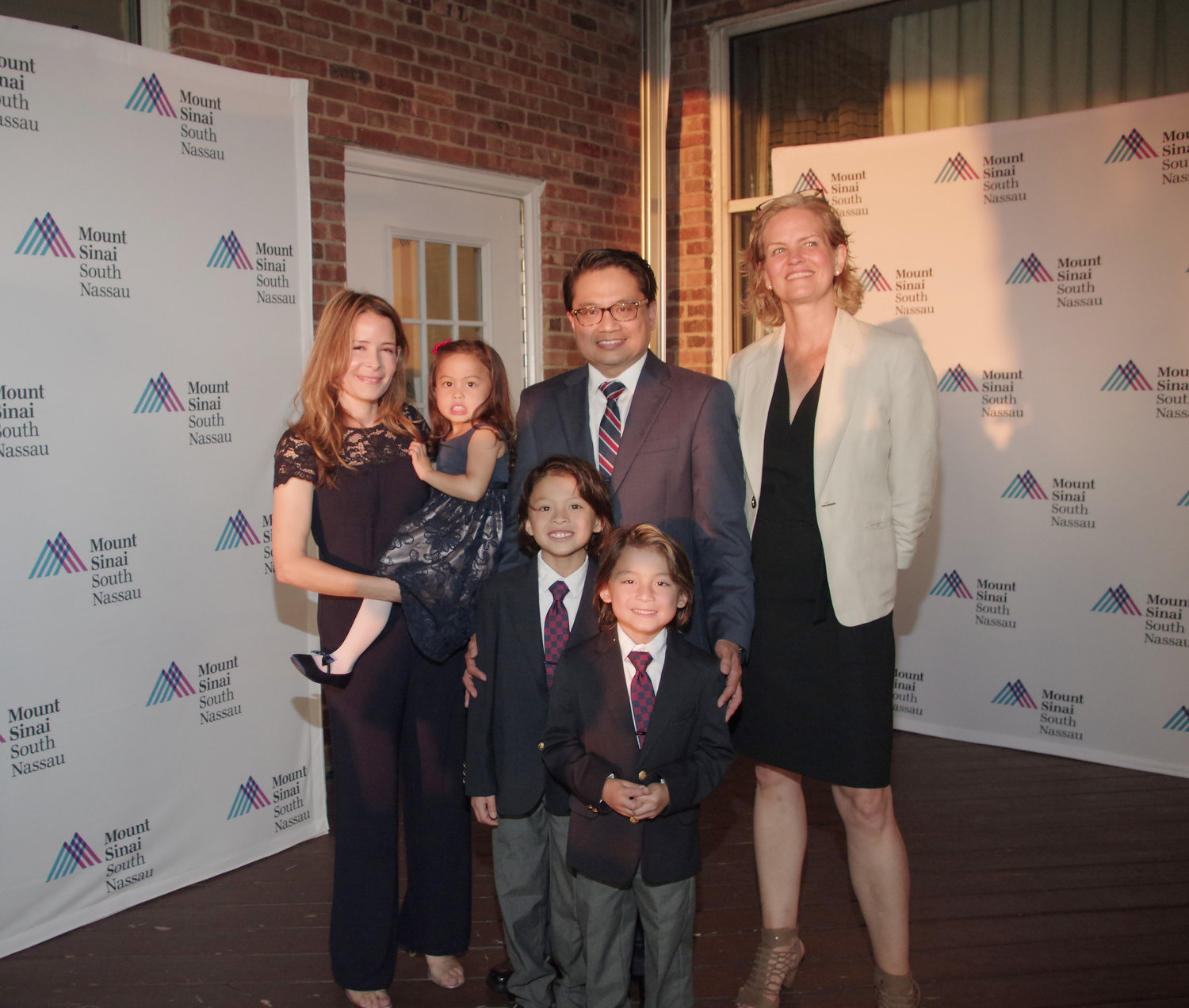 Cruz, second from right, enjoyed the honor with his wife, Kristine, far left, their three children, Riley, Tyler and Mia, and Nassau County Executive Laura Curran.