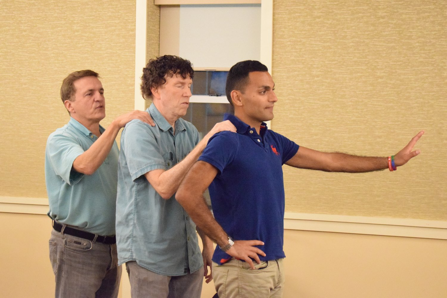 "Rich Buckley, left, Ken Cohn and Michael Harrington, members of the CTI Theatre of Glen Cove, rehearsed for the upcoming premiere of ""They're Playing Our Song."""