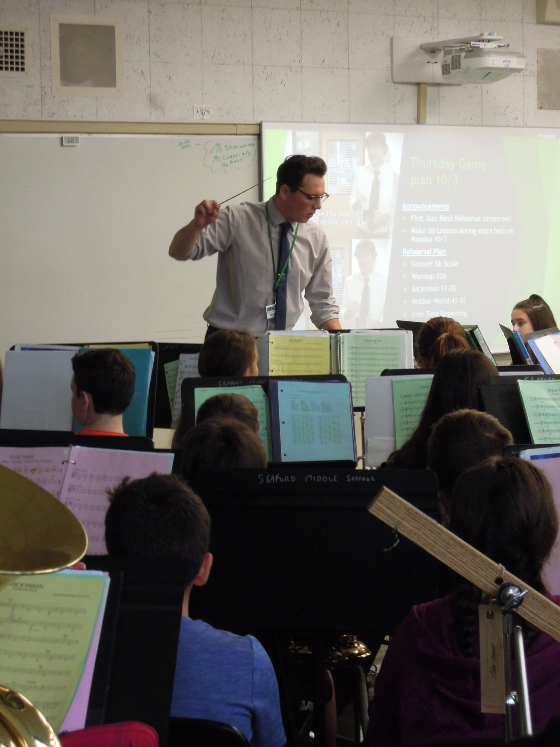 Nick Coacci working with the Seaford Middle School's 83-member sixth-grade band.