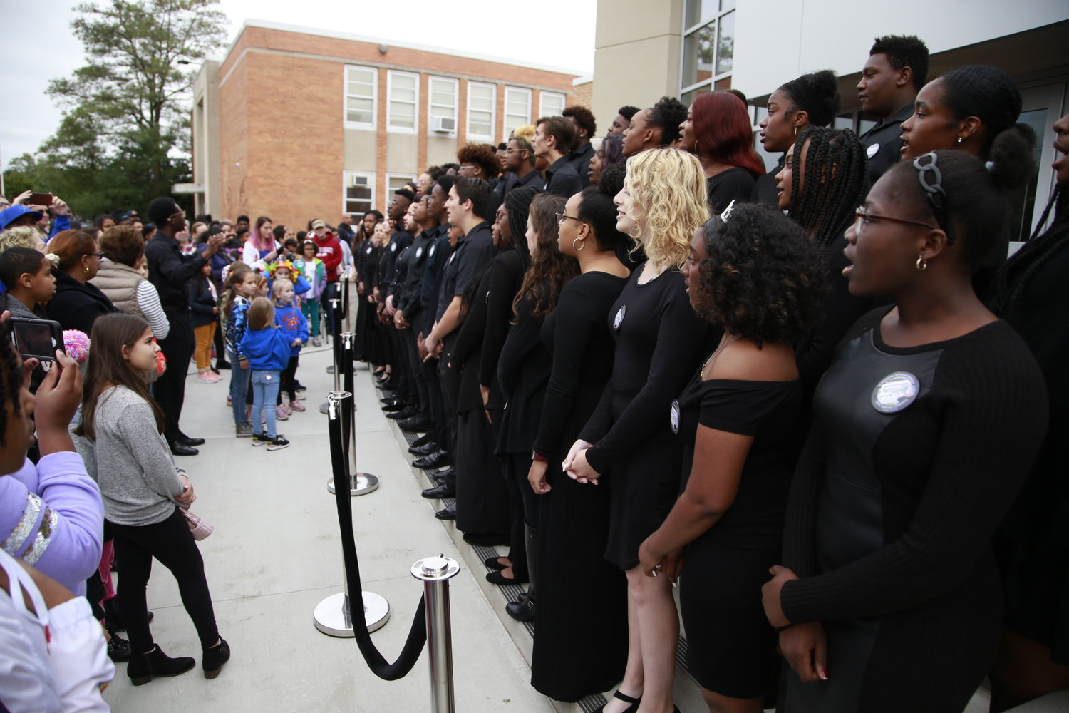 The high school's select choir sang the national anthem to start the ceremony.