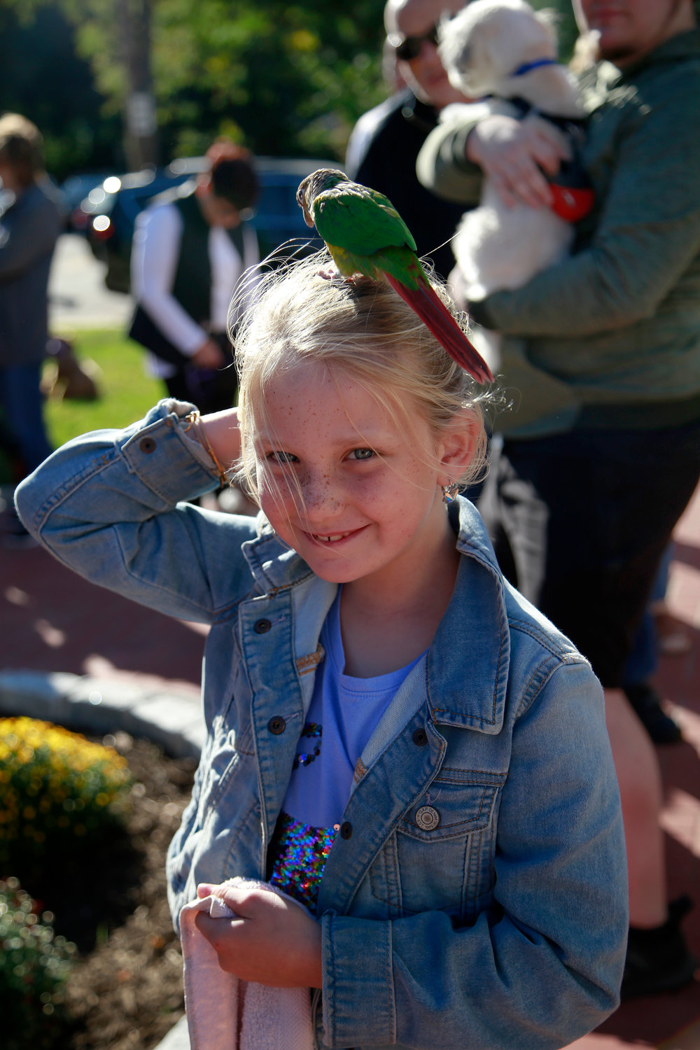 Charlotte Fitzgerald brought her conure parrot, Skittles, to the ceremony.