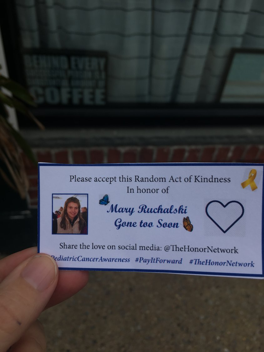 "Those who received a free meal or free lacrosse balls were given an honor card with a photo of Mary Ruchalski and were encouraged to ""share the love."""