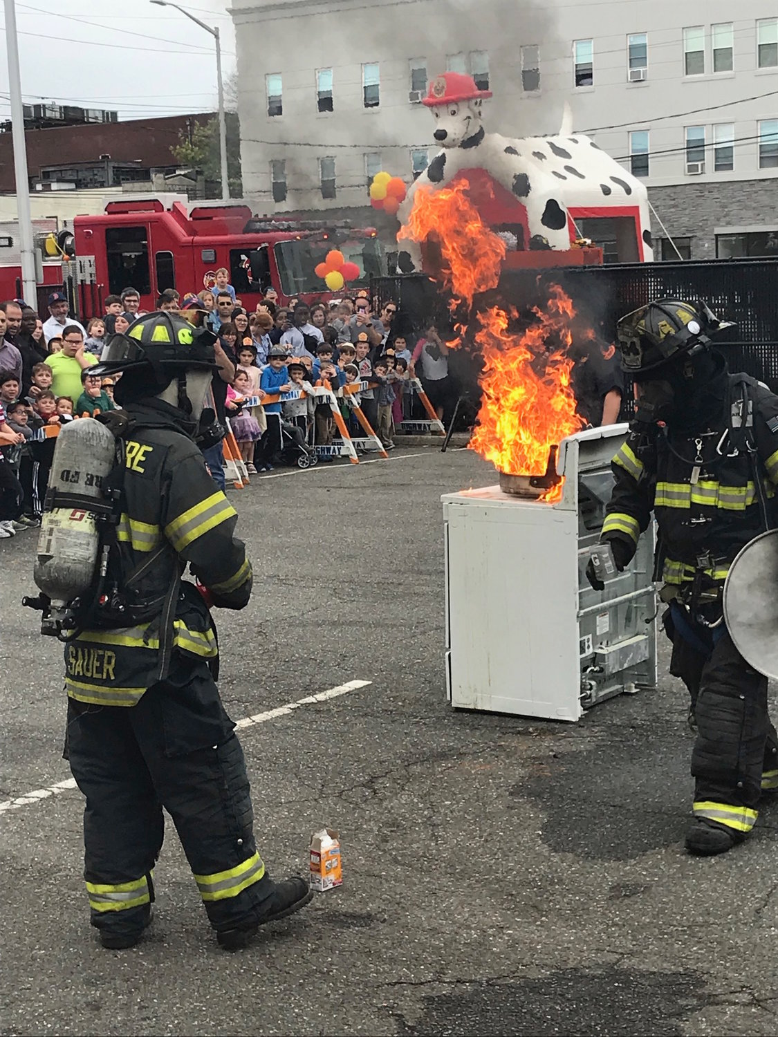 Woodmere firefighters showed Fire Prevention Day visitors how they go about extinguishing a kitchen fire.