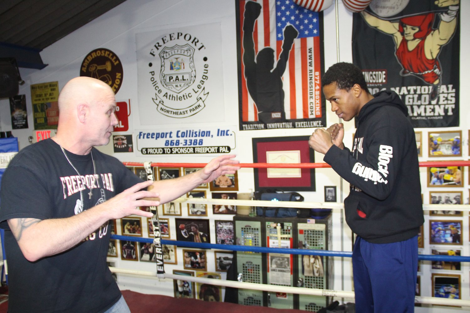 Coach Joe Higgins with Day in March 2018, before Day defended his World Boxing Council Continental Americas title in the 154-pound weight class against Kyrone Davis. Day suffered a traumatic brain injury in his most recent fight, and at press time he was in a coma.