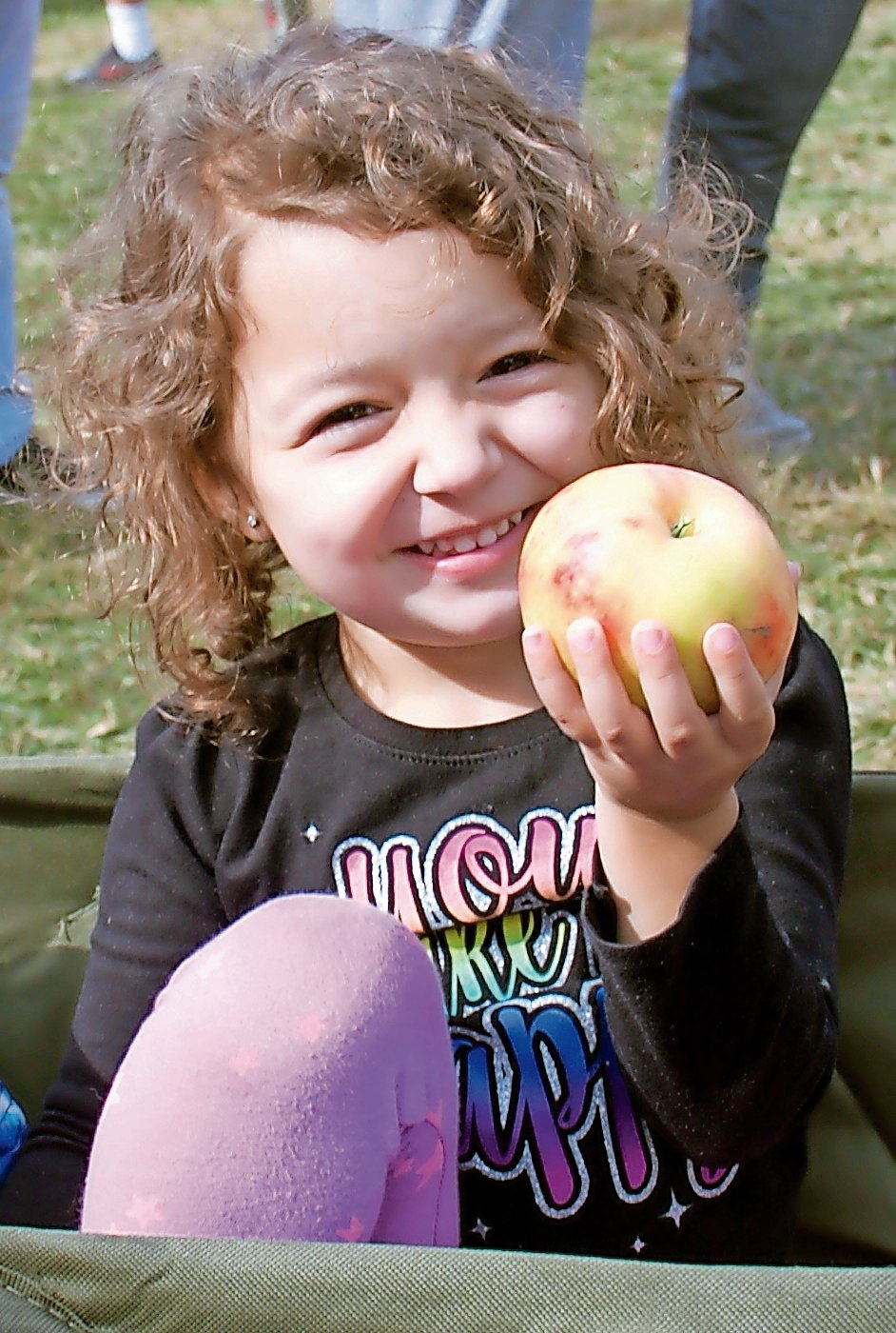 Phoebe Bougiamas, 3, picked out an apple to bring home to eat later.