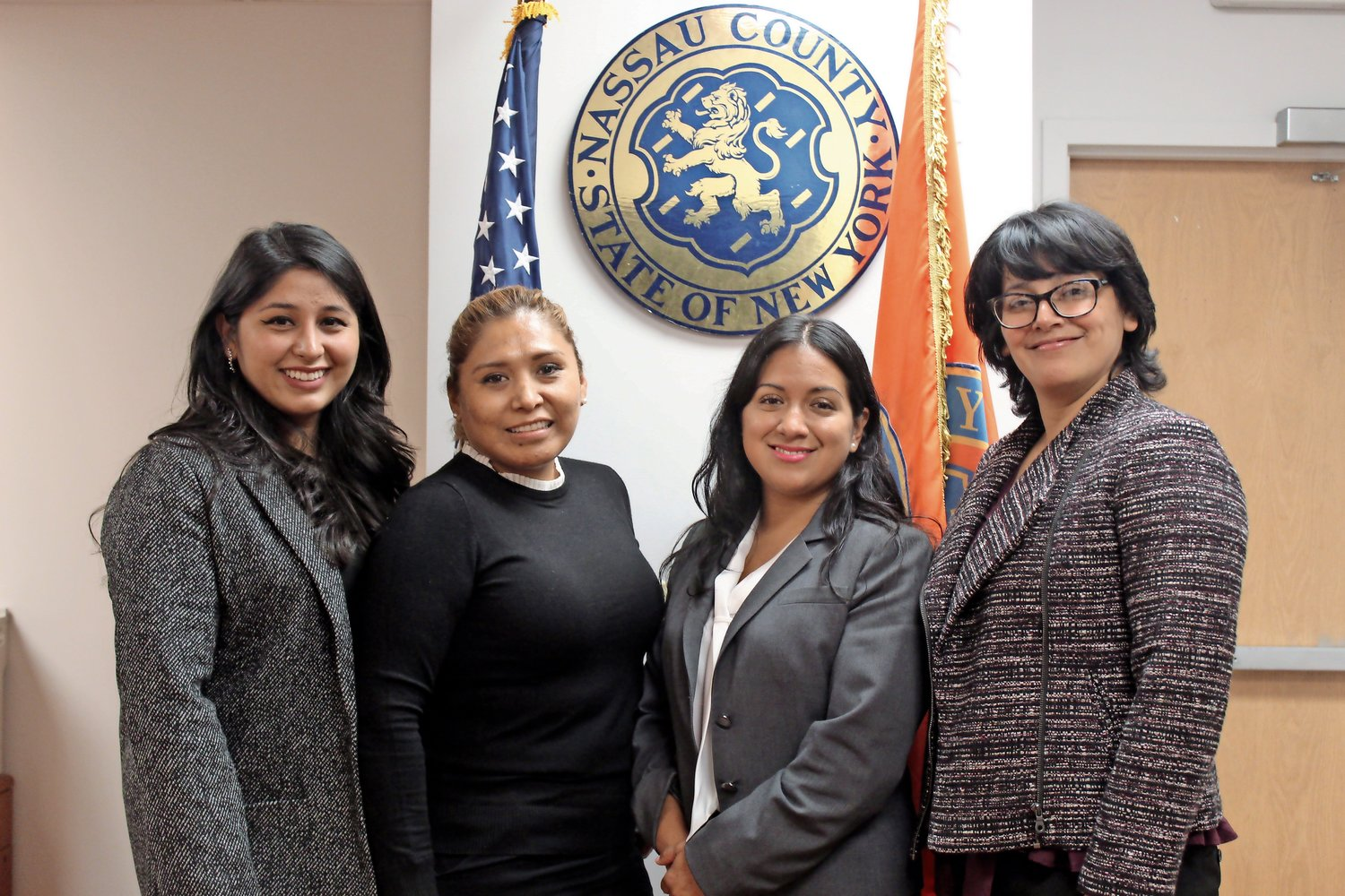 Running the Office of Hispanic Affairs is administrative aide Estefany Ruiz, left, program coordinator Yolanda Martinez, Flores and deputy director Lucia Martinez.