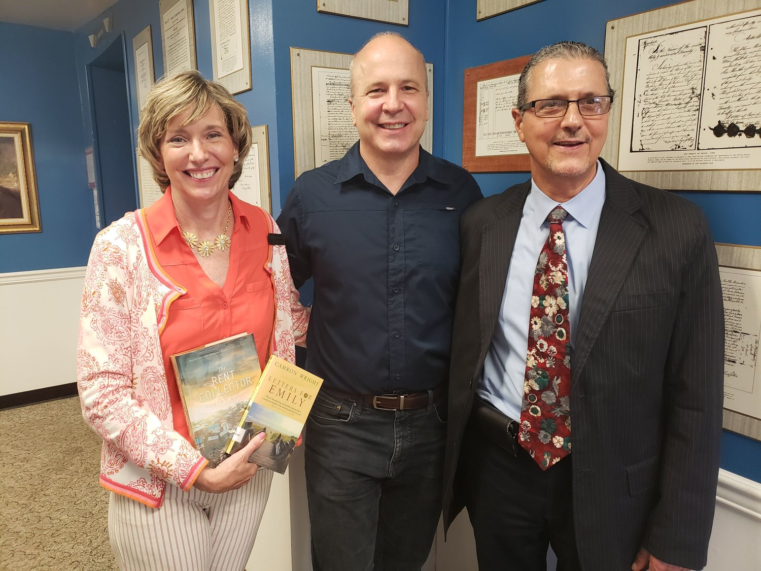 Freeport Memorial librarian Brid Halter, left, with Wright, center and Library Director Ken Bellafiore following a luncheon and discussion of his bestsellers, The Orphan Keeper and The Rent Collector.