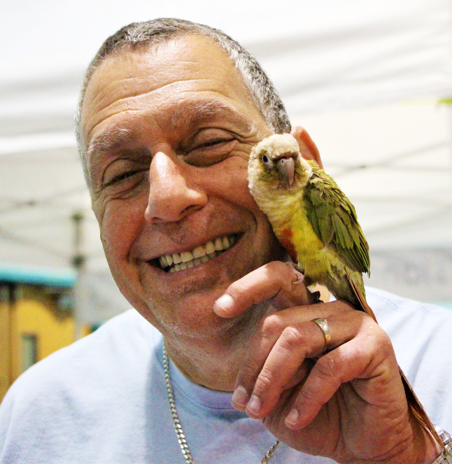 Robert Gross was all smiles with Rio, the green-cheeked pineapple conure.