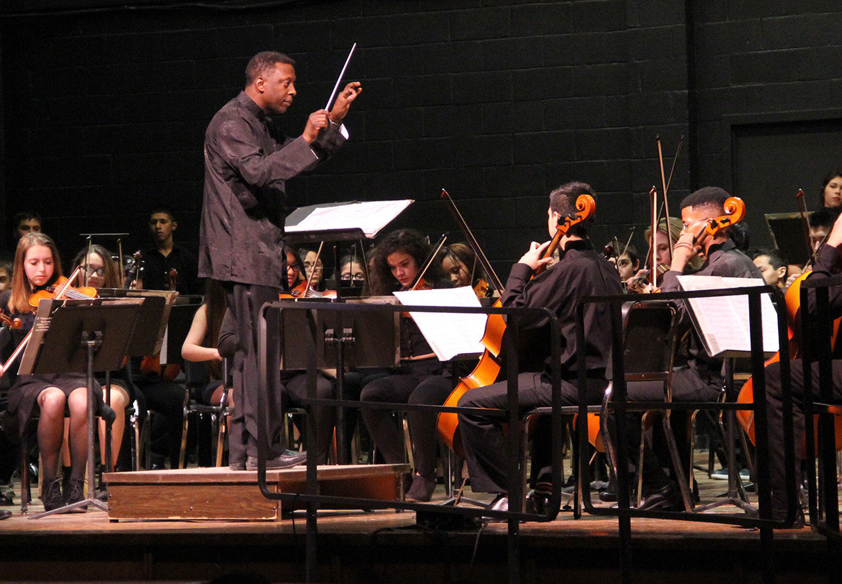 "Terrence Batts conducting the Lawrence High School orchestra in 2015. He said he was kept out of Honors classes as a student in the 1960s and '70s, despite his clear academic abilities. Many students of color, he said, are automatically placed in lower-track classes, without regard to what he calls ""intellectual heft."""