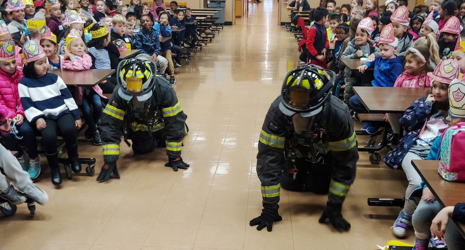 East Meadow Fire Department firefighters demonstrated a search pattern at Barnum Elementary School to ensure the children have no fear of their masked appearance.