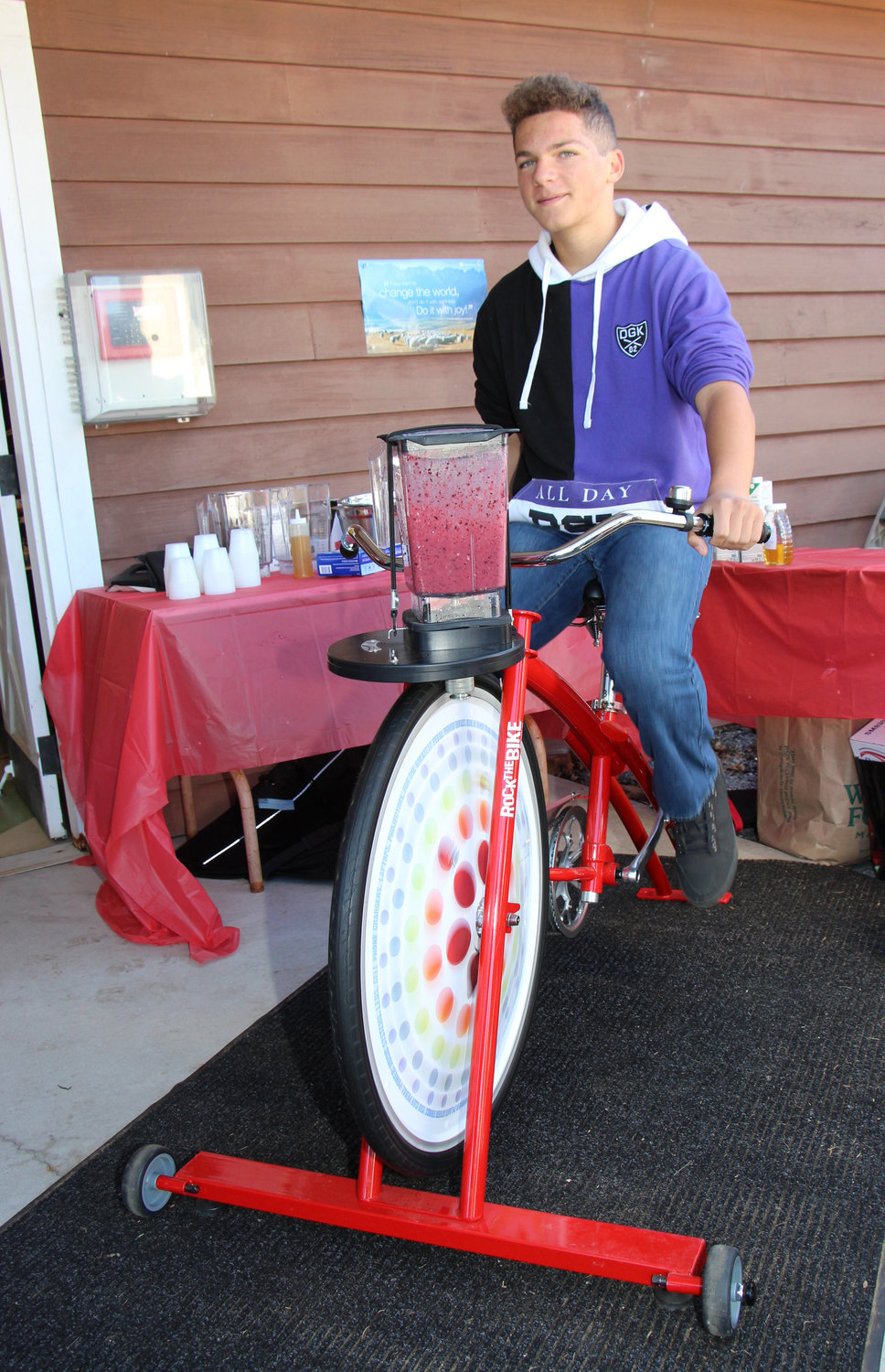 Anthony Patti, 15, rode Rock the Bike, which operates a blender he used to male a mixed berry smoothie.