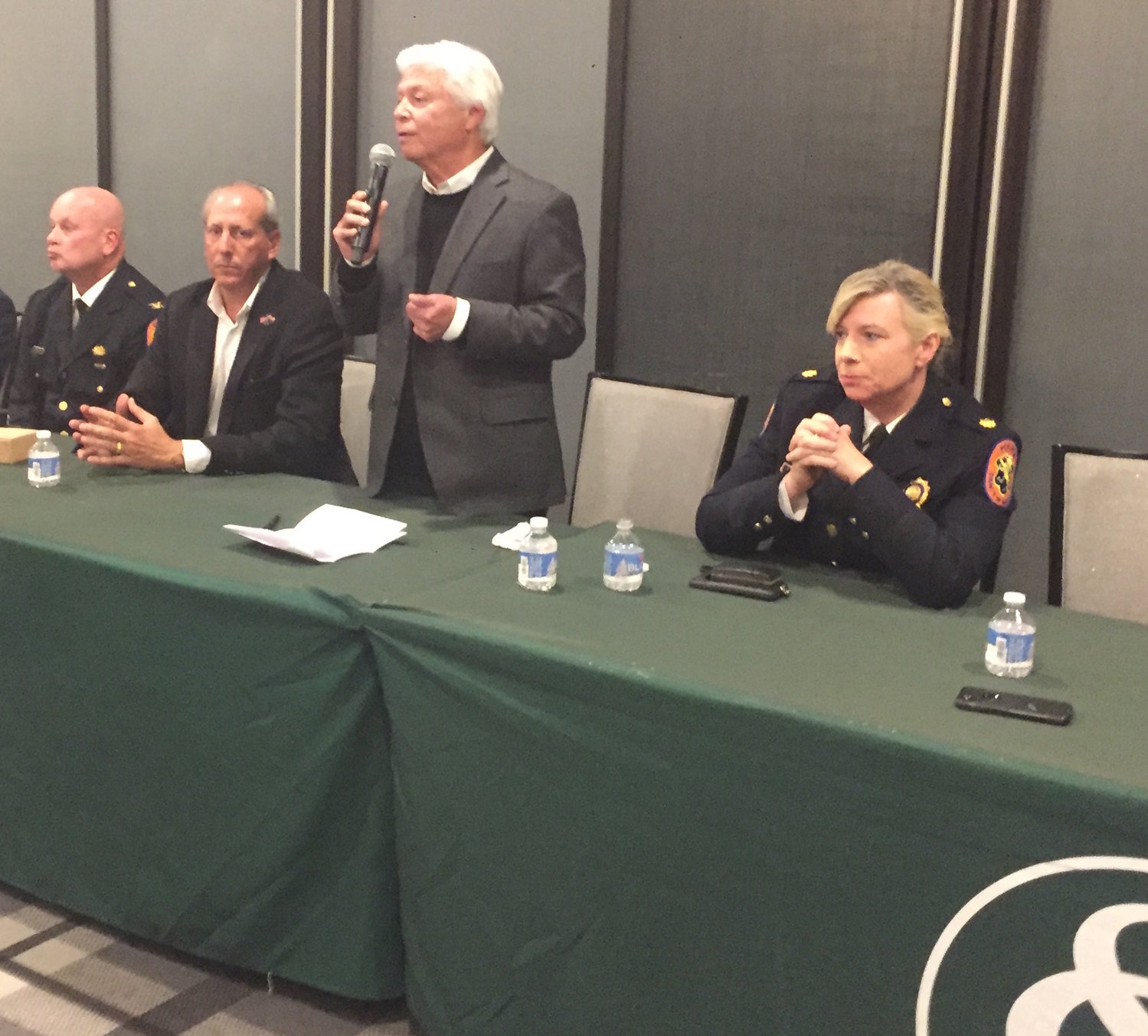 Hewlett Harbor Mayor Mark Weiss addressed residents at the Seawane Country Club on Oct. 15 about recent criminal activity in the village. With him were, from left, 4th Precinct Commanding Officer Joseph Barbieri, village Trustee Tom Cohen and Sgt. Leslie Moulds.