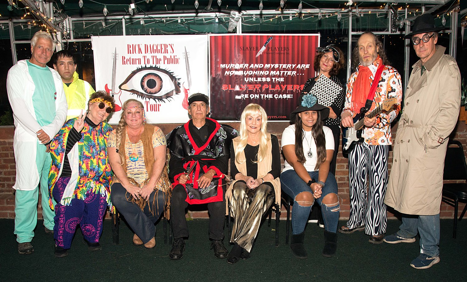 The 16-person cast of characters, 10 who are pictured here, are eager to premiere the Slayer Players' Halloween-themed murder mystery.