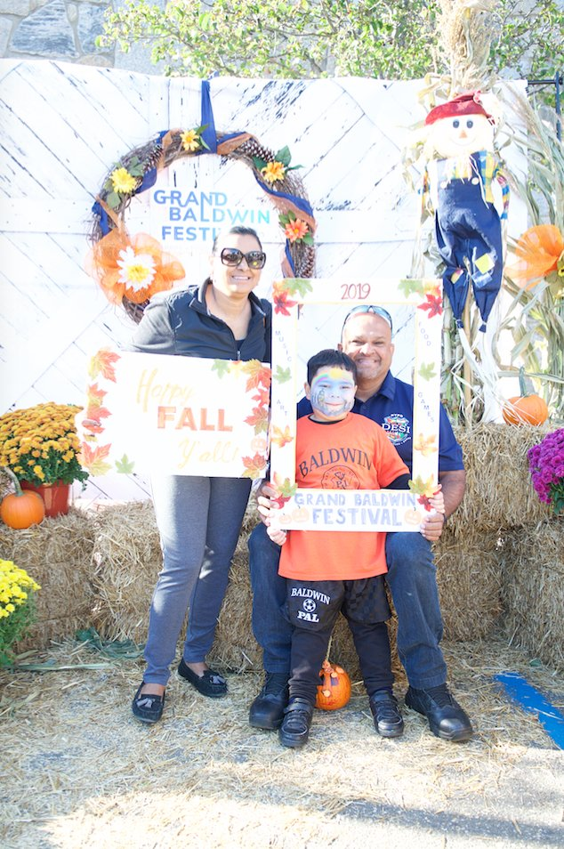 Sandy, Kris and Ravi Singh posed for a fall-themed family photo.