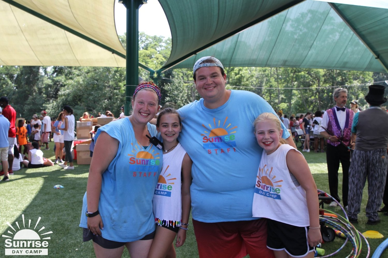 Levy worked at Sunrise Association Day Camp in Wheatley Heights with his sister, Jessica, far left. The two enjoyed a summer day with campers Seraphina, left, and Catherine O'Brien.