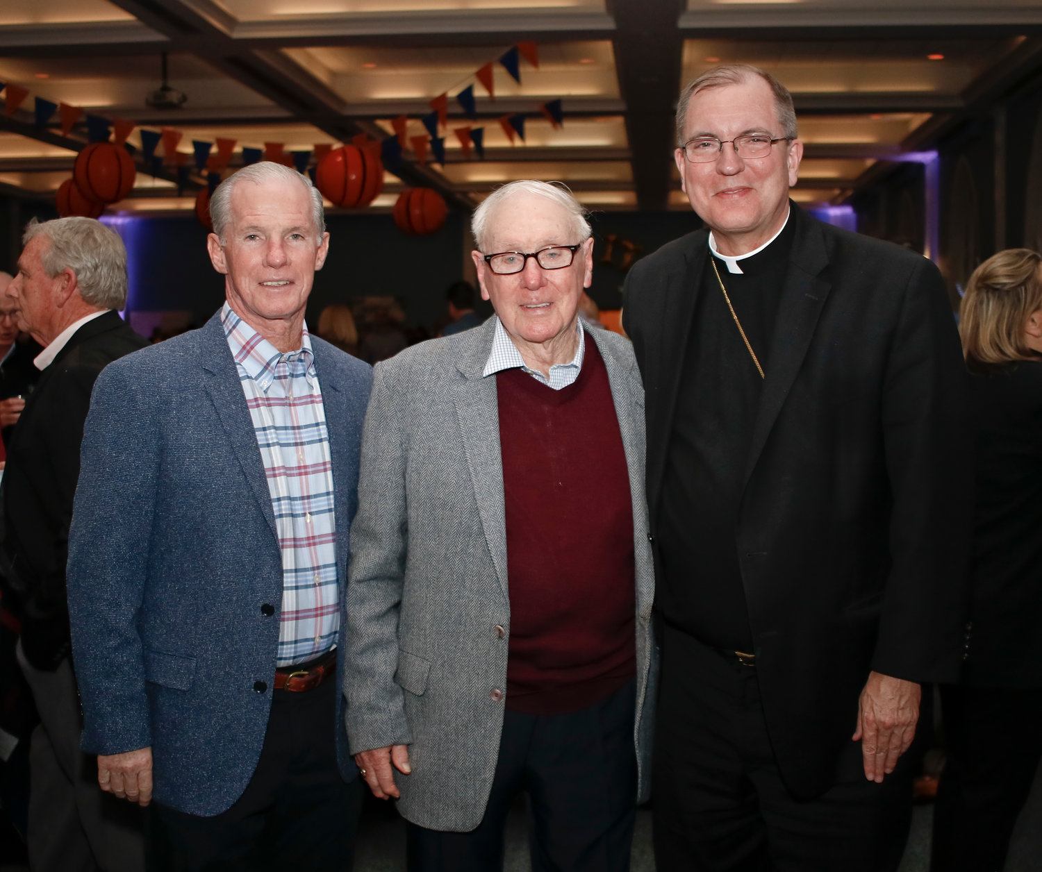 William Croutier Sr., center, poses with his son, Bill Croutier Jr. and Bishop John O. Barres. Croutier was surrounded by family, friends and comunity members at the celebration in his honor on Oct. 19 at St. Agnes Parish.