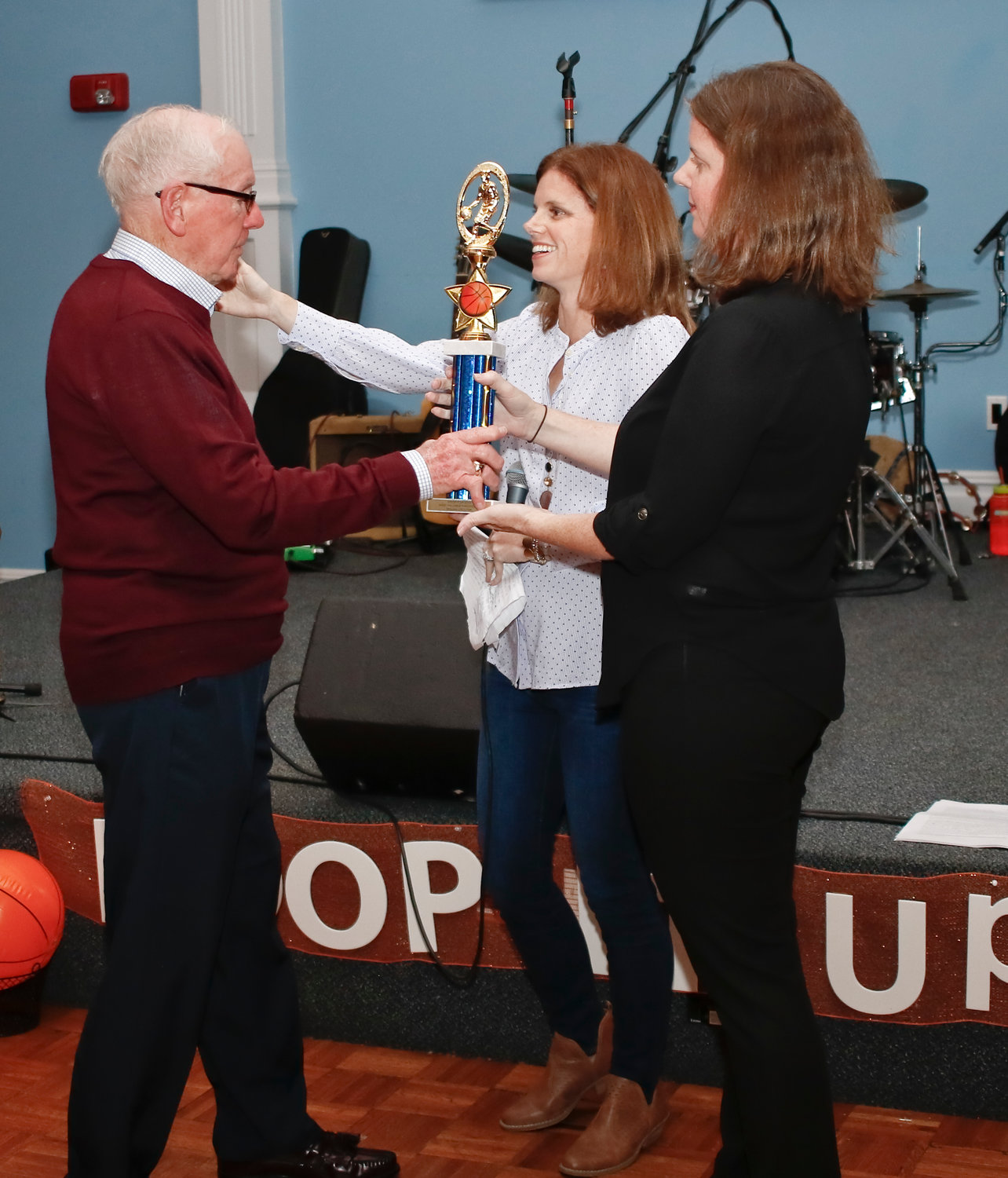William Croutier's granddaughters, Jennifer Muldoon and Maggie Regan, presented him with an MVP (most valuable parishioner) trophy at the dinner in his honor.