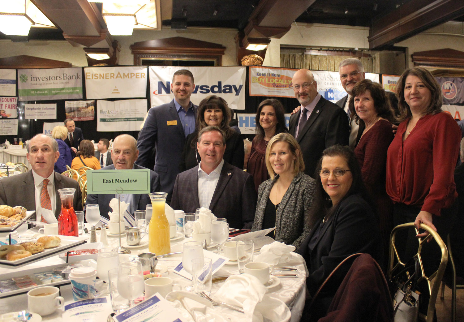 Members of the East Meadow Chamber of Commerce saluted Mitchell Allen, standing, center, at the 35th annual Businessperson of the Year and Legislative Breakfast.