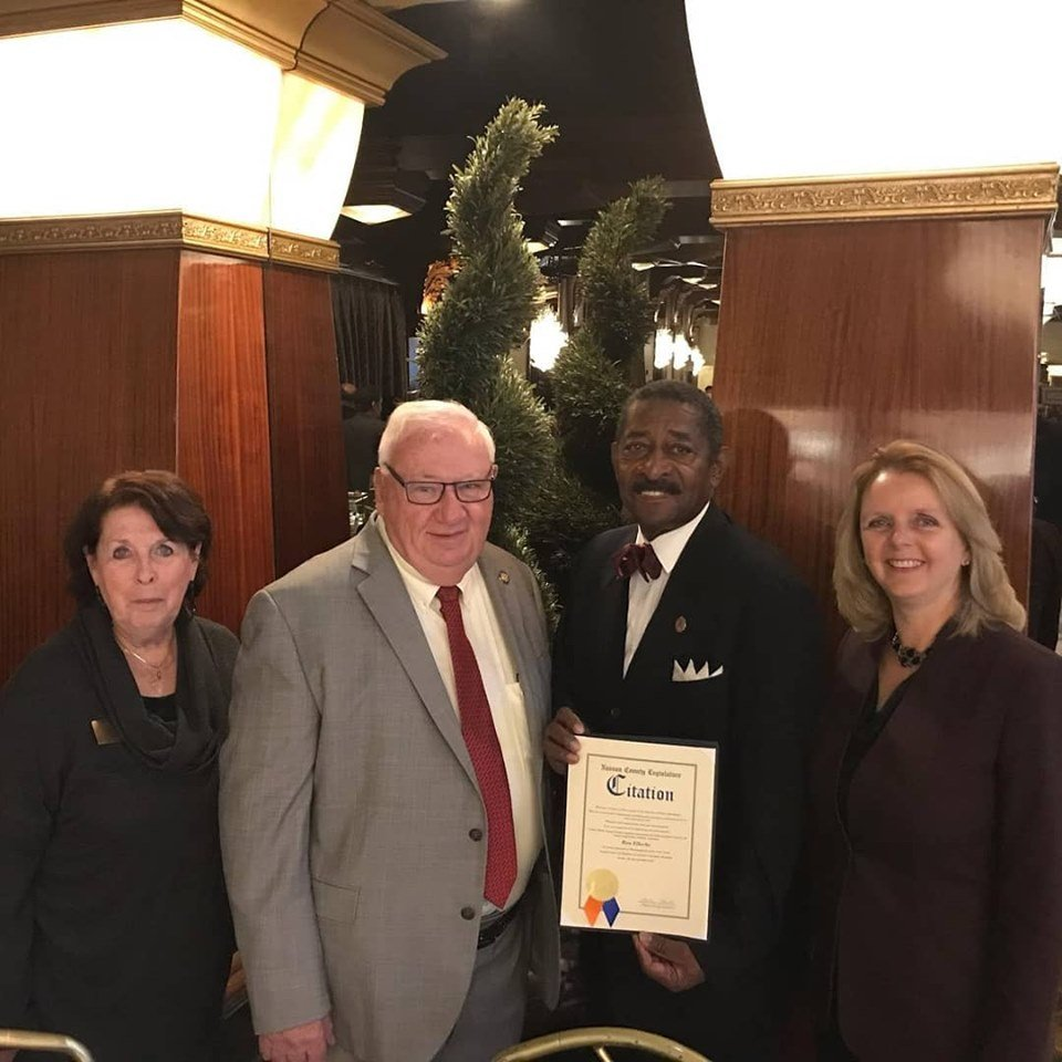 Freeport Chamber of Commerce Past President Lois Howes, far left, State Sen. John Brooks and County Legislator Debra Mulé, right, joined Ellerbe at the Nassau Council of Chambers of Commerce's 35th annual awards breakfast on Oct. 18.
