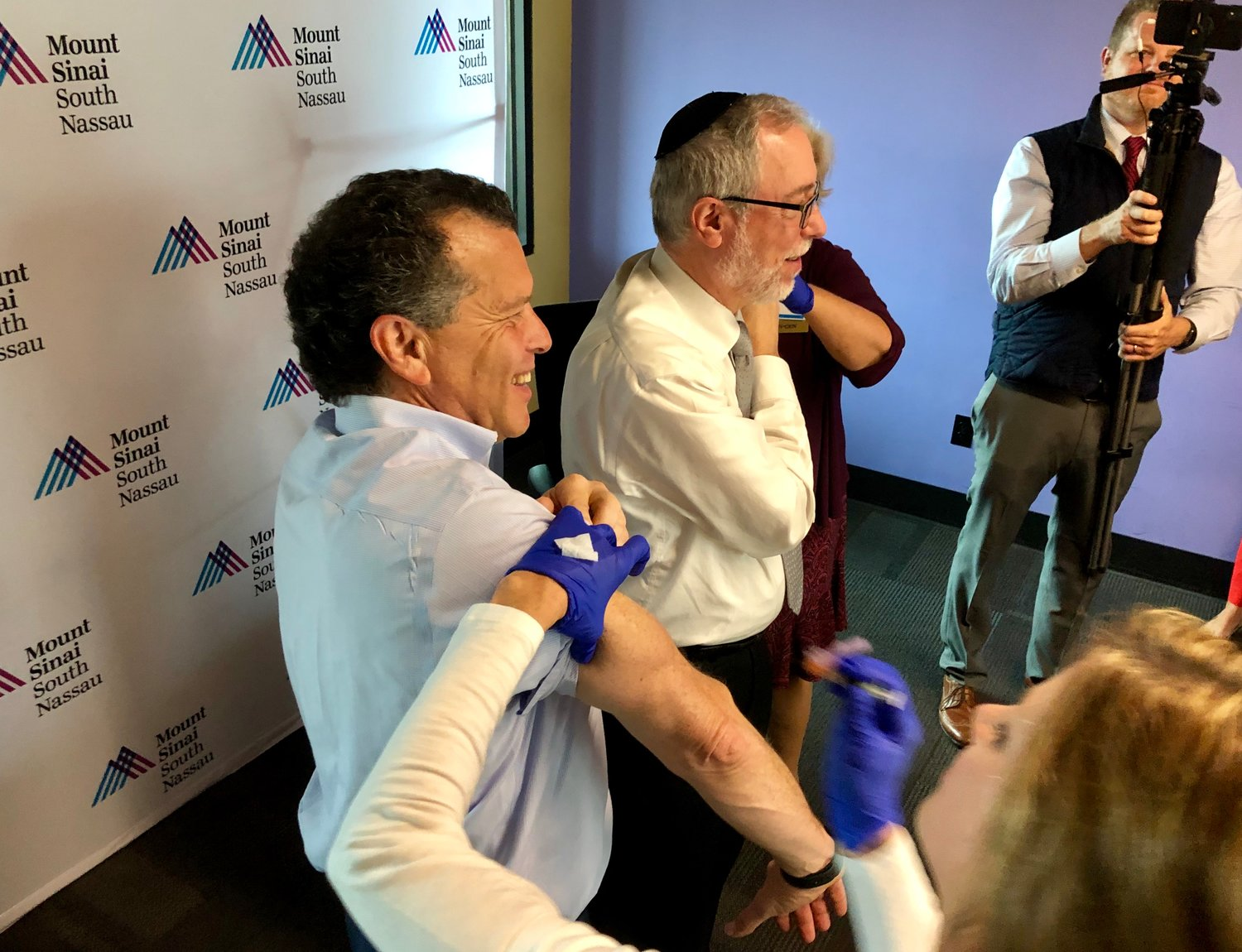 Dr. Aaron Glatt, right, chairman of the Mount Sinai South Nassau Department of Medicine, and Stuart Richner, publisher of Herald Community Newspapers, rolled up their sleeves to get their flu shots together at the Heralds' offices in Garden City on Oct. 29.