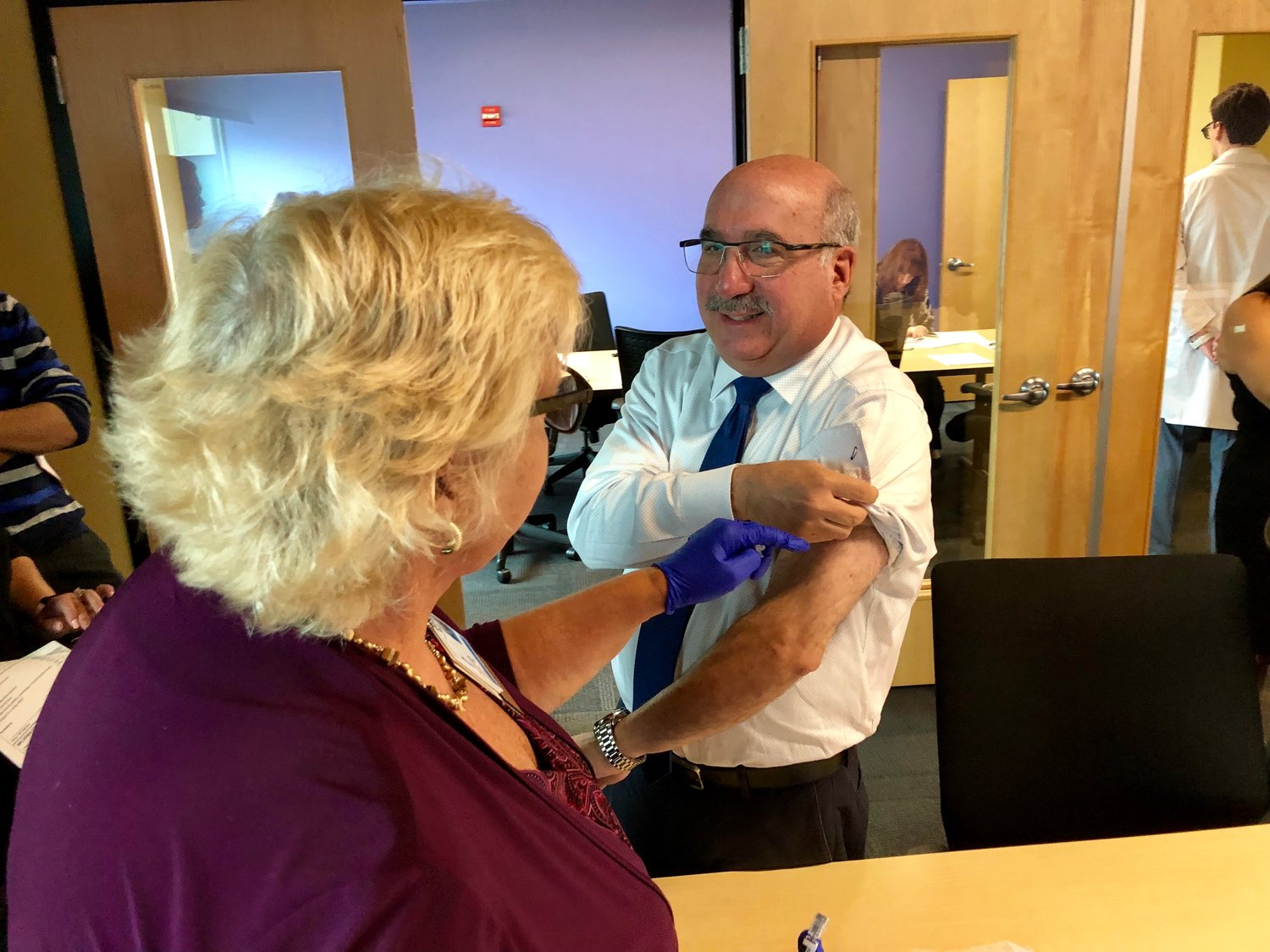 Marty Goldenberg, advertising sales account executive for the Rockville Centre Herald, received his shot from Kate Zummo, MSSN director of community education and a registered nurse.