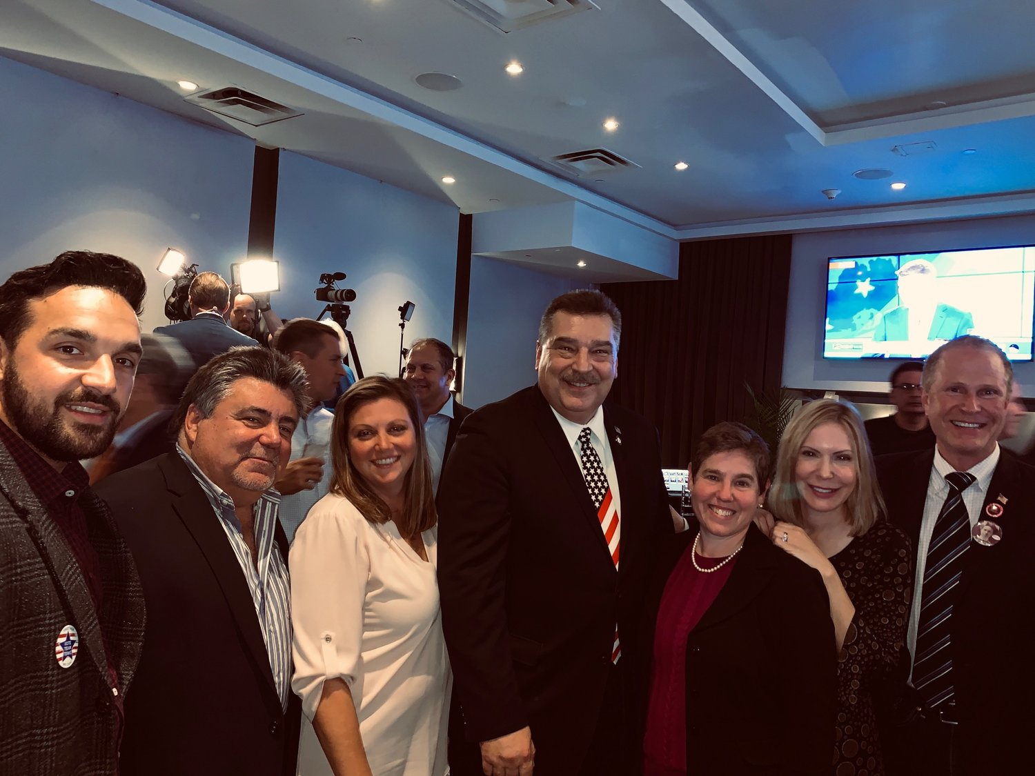 Geln Cove Democrats, from left, Rocco Totino, John Perrone, Danielle Fugazy Scagliola, Timothy Tenke, Marsha Silverman, Eve Lupenko Ferrante and Gaitley Stevenson-Mathews celebrated their victory.