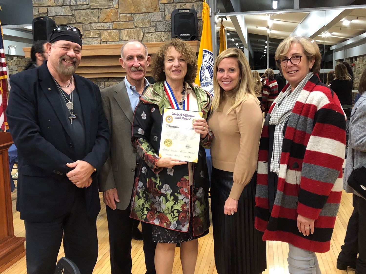Hempstead town presented its Make a Difference awards on Oct. 29. From left were Rock and Wrap It Up! founder Syd Mandelbaum, Bob Fischman, award winner Rhonnie Fischman, Supervisor Laura Gillen and Diane Mandelbaum.