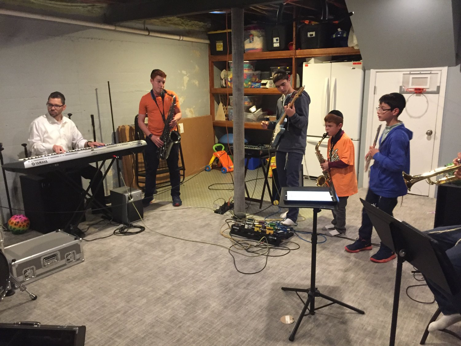 Rock Mishpacha had a quick rehearsal session in when a reporter visited on Oct. 10. From left, Rabbi Aaron Ross, BZ, Avi, Yehuda and Moshe. Not pictured: Mordy, Batsheva, Dovid and Miriam.
