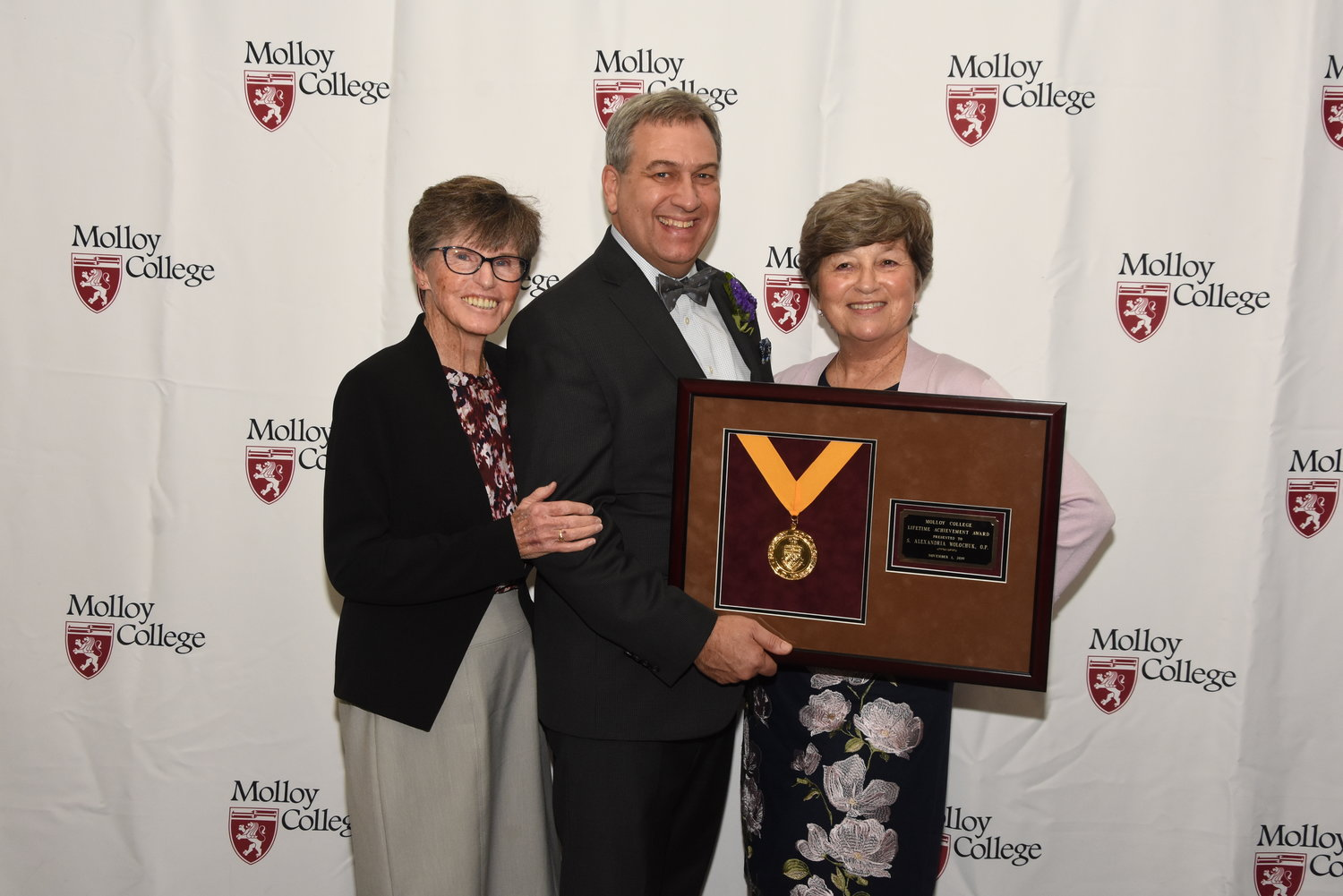 Sister Alexandria Wolochuk, recipient of the Lifetime Achievement Award, with, from left, Sister Margaret McVetty from Molloy College Board of Trustees and Molloy College President Dr. Drew Bogner.