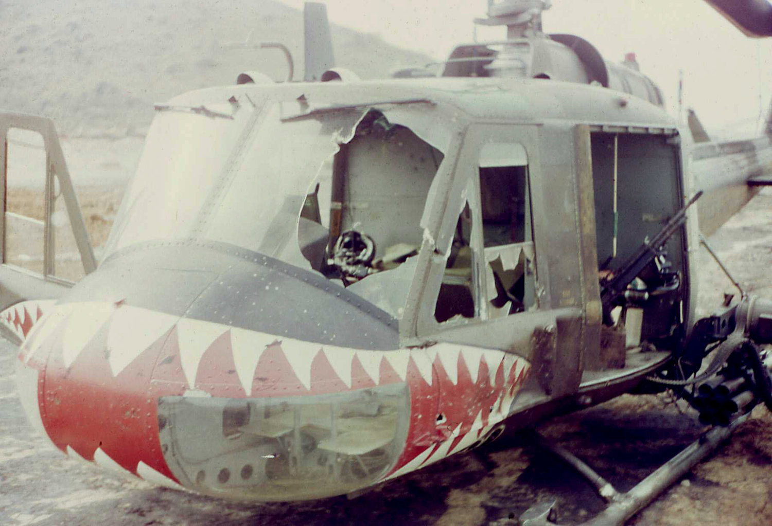 A damaged Bell UH-1C, or Huey, helicopter. Mason flew this attack variant of the famous aircraft in Vietnam, and went down in a monsoon near Saigon.